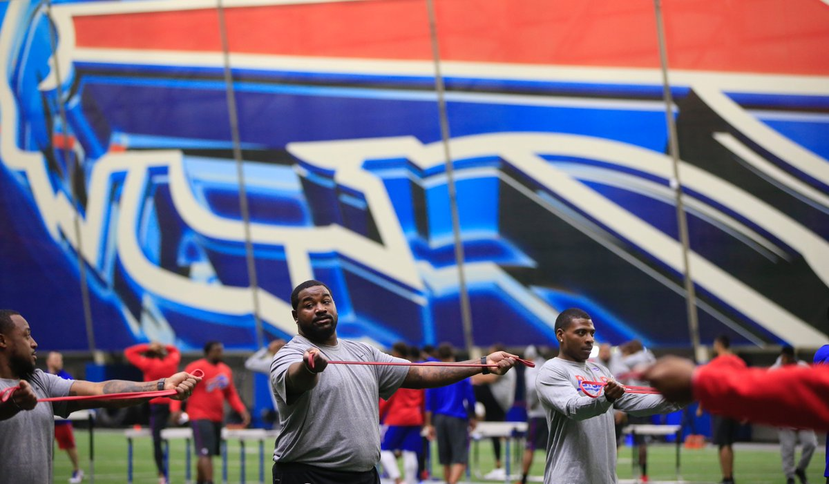 Bills defensive tackle Marcell Dareus stretches during the first day of voluntary offseason workouts. (Harry Scull Jr./Buffalo News)