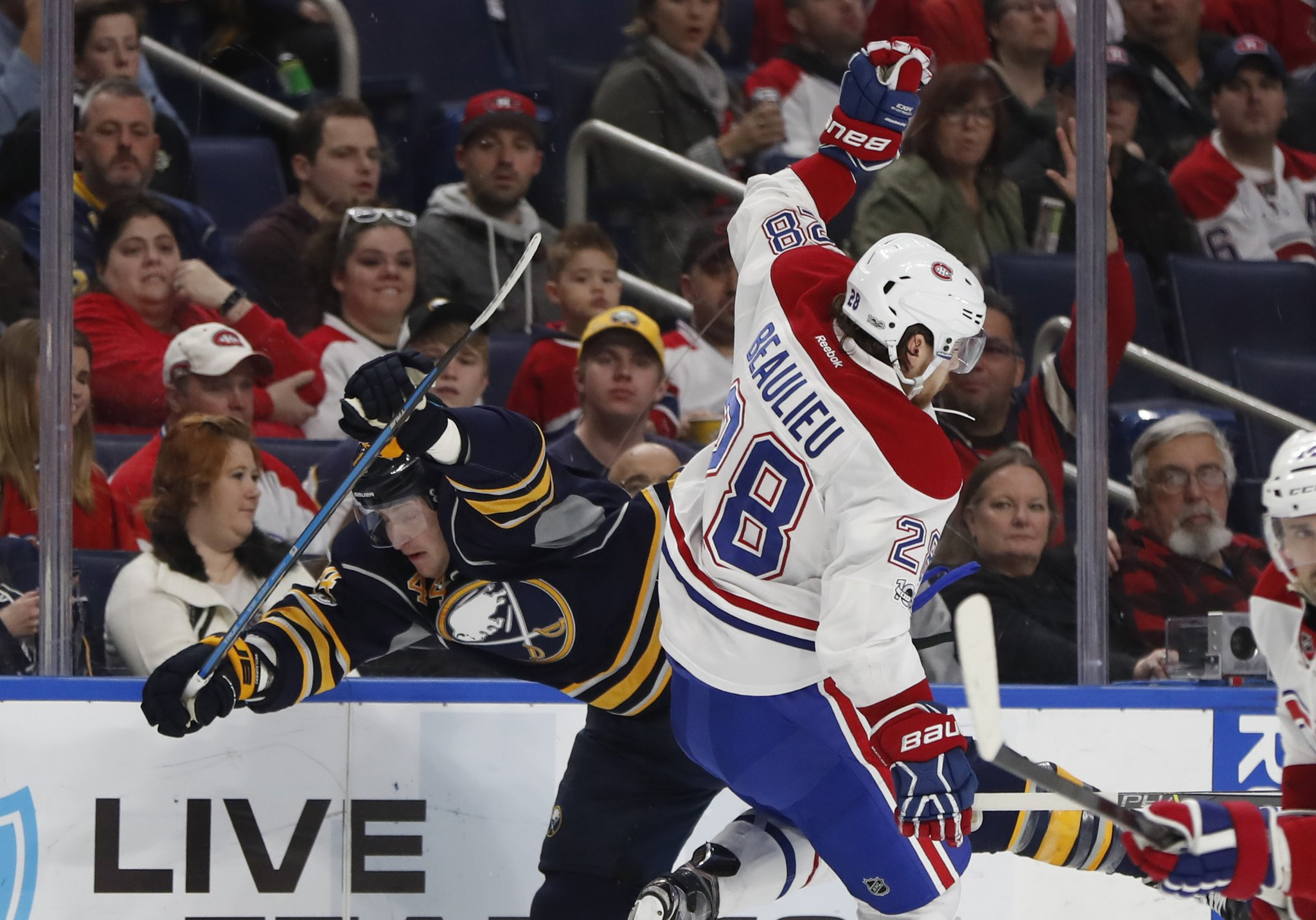 The Sabres' Nicolas Deslauriers and Montreal's Nathan Beaulieu collide during the first period Wednesday. (Harry Scull Jr/Buffalo News)