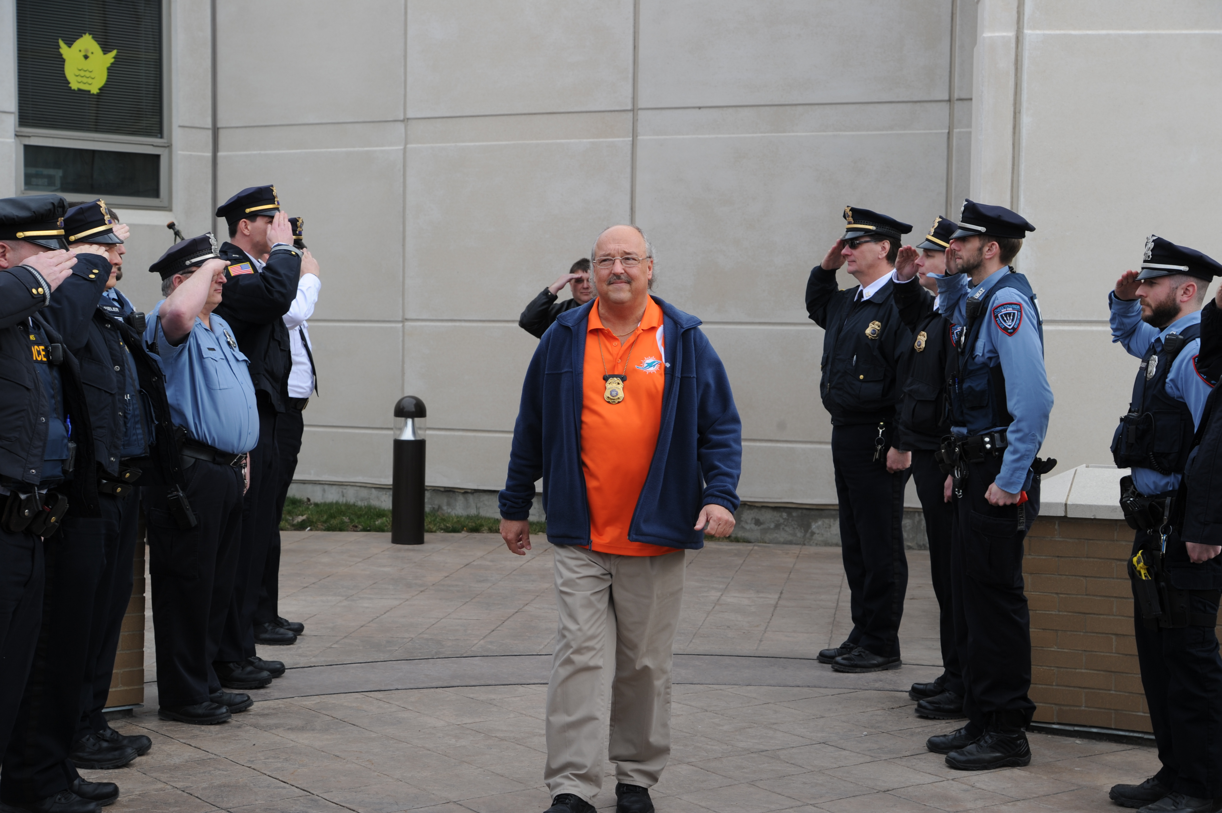 Retiring Cheektowaga Police Detective Mark Jedd receives a goodbye salute on his last day at the office.
