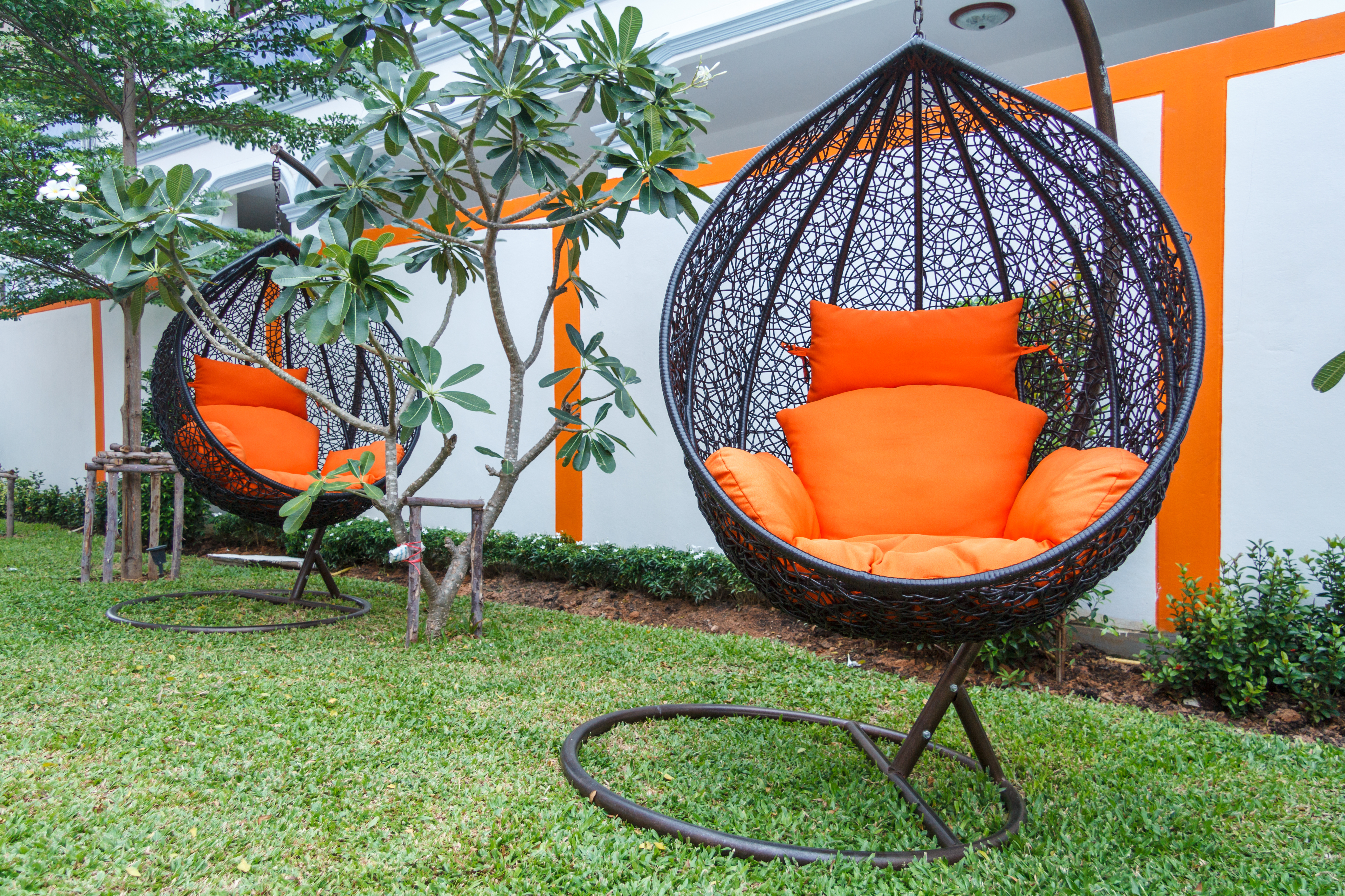 Hanging chairs and the color orange, shown here in an unidentified location, are enjoying a comeback this spring.