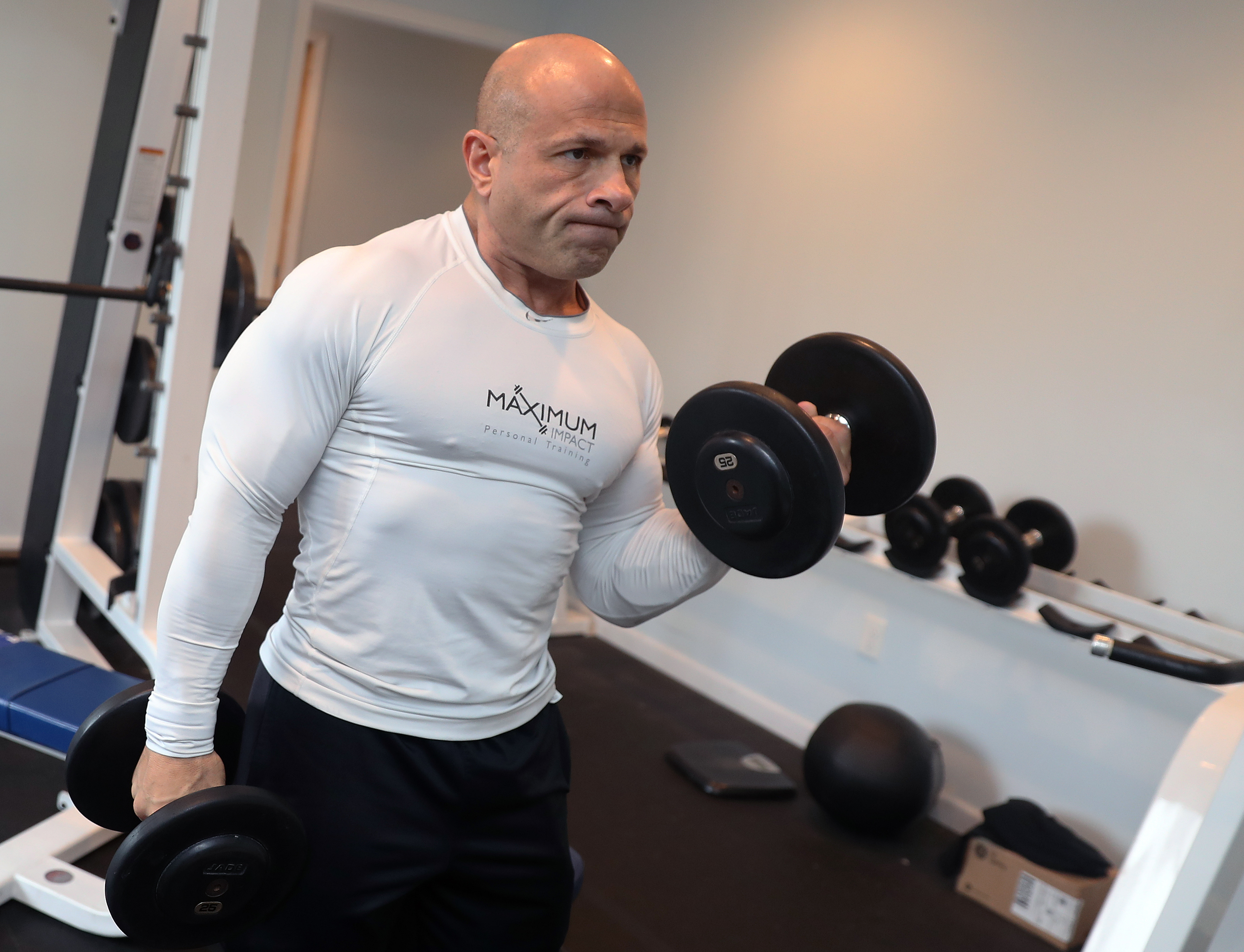 Dino Fudoli, the former Lancaster town supervisor, lifts weights at Maximum Impact, a gym he owns in Lancaster. (John Hickey/Buffalo News)