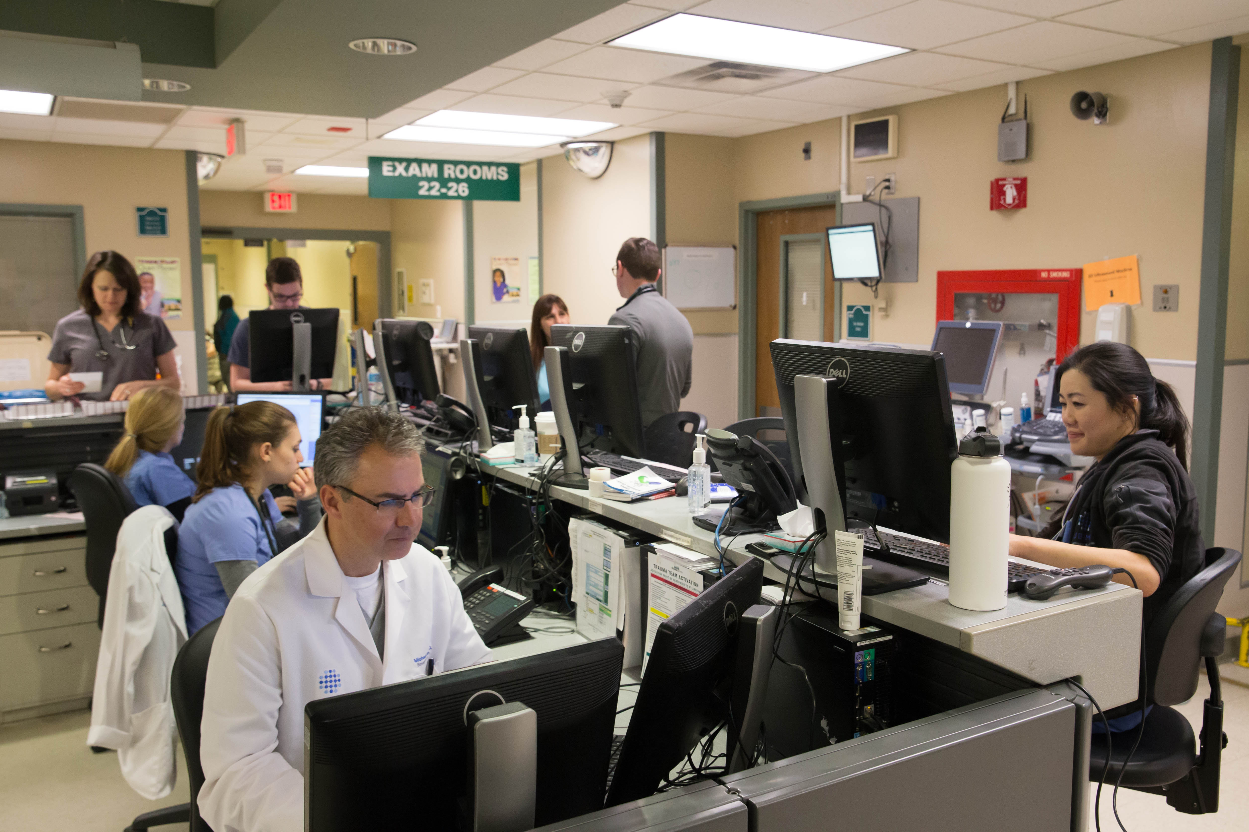 Erie County Medical Center staff crowds around the central workspace in the ECMC Emergency Department in this file photo from Monday, Feb. 27, 2017.  (Derek Gee/Buffalo News)