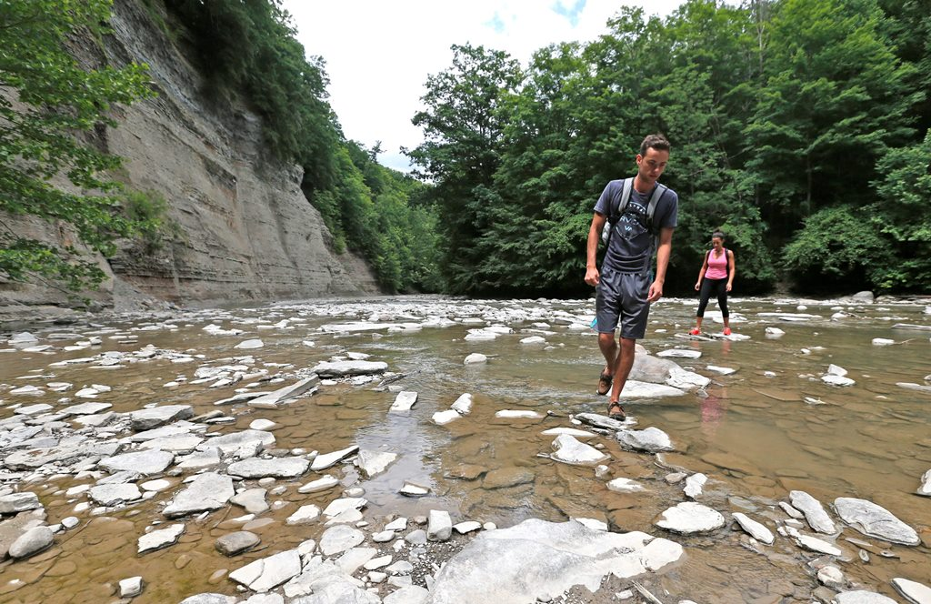 Hiking companions Zachary Szafranek of Buffalo and Jessica Pieters of Amherst explore the Zoar Valley gorge last summer. Cattaraugus Creek has been carving into the stone bottom of the gorge for thousands of years. (Robert Kirkham/Buffalo News)