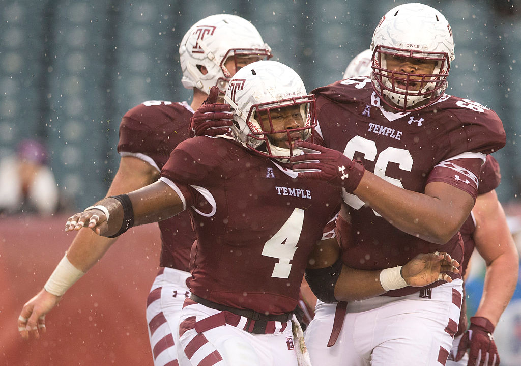 Temple lineman Dion Dawkins (66) and Running back Kenneth Harper react after Harper scored a touchdown in the first half against the East Carolina Pirates on November 1, 2014 at Lincoln Financial Field in Philadelphia, Pennsylvania. (Getty Images)