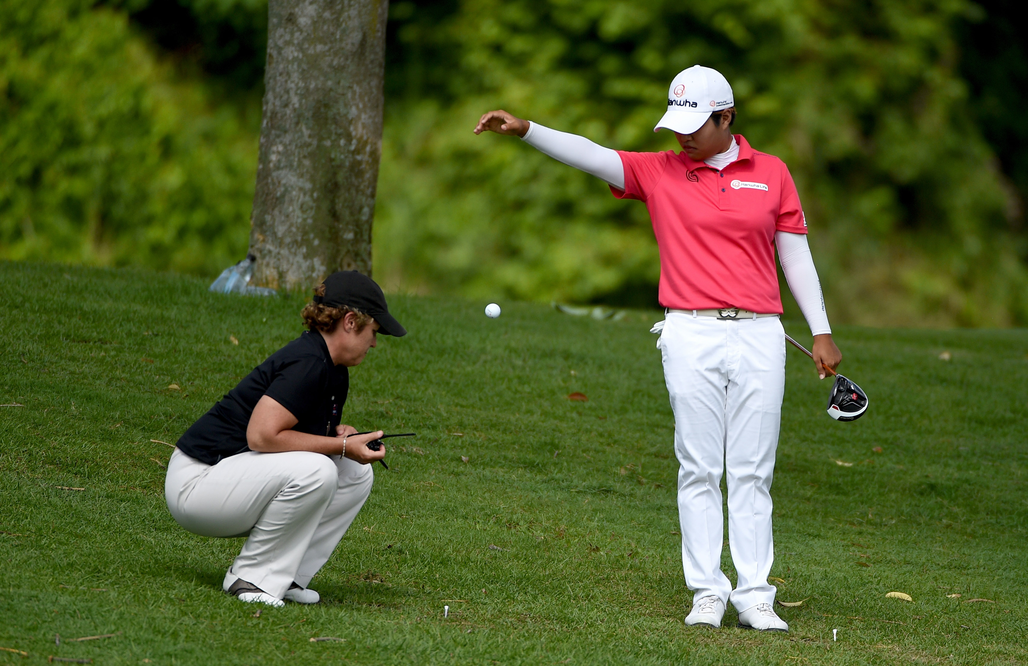 Japan's Haru Normura takes a free drop at an LPGA event in 2016. Golfers will not have to drop from shoulder height starting in 2019. (Photo by Ross Kinnaird/Getty Images)