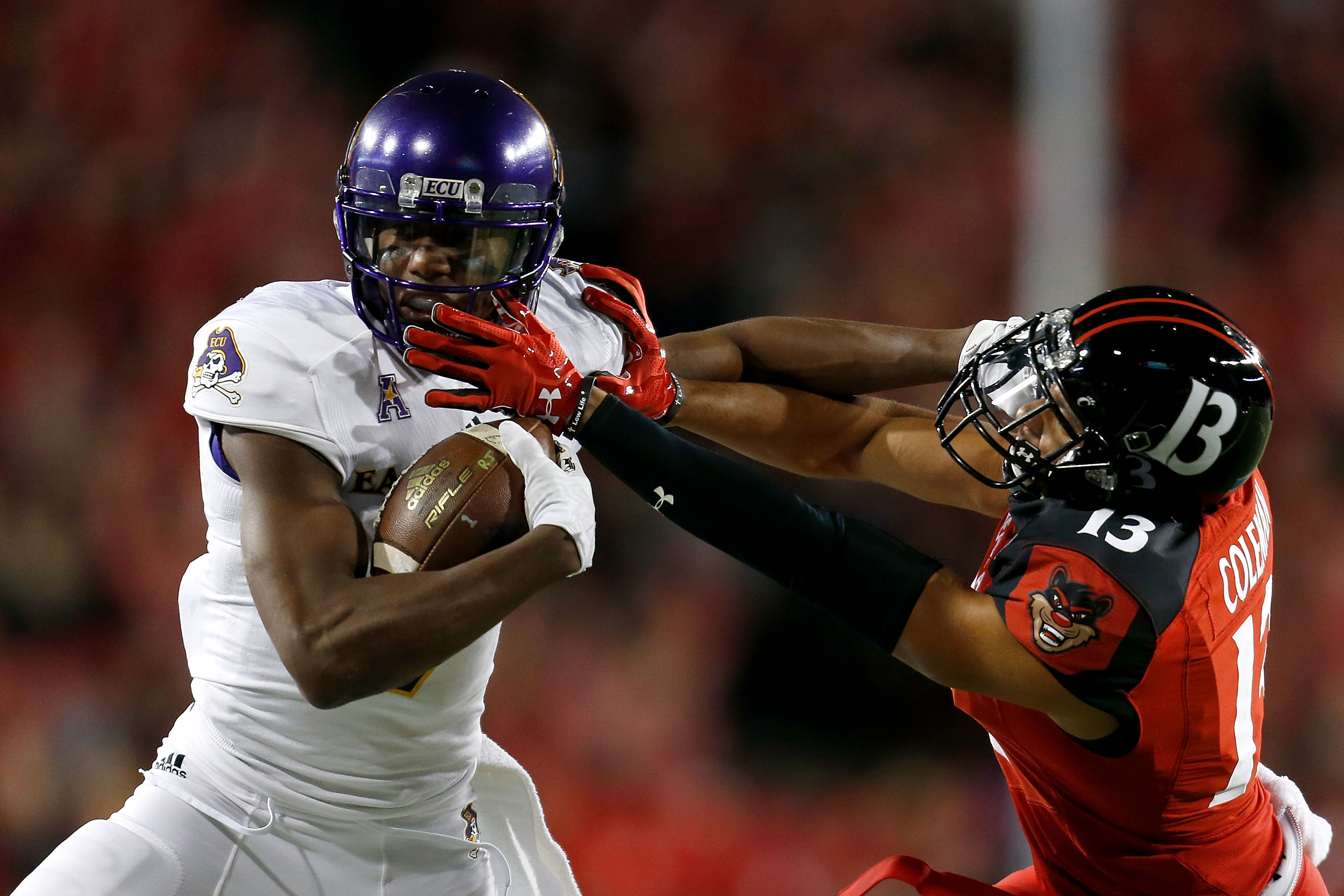 East Carolina's Zay Jones, left, set an NCAA record with 158 catches last season. (Getty Images)