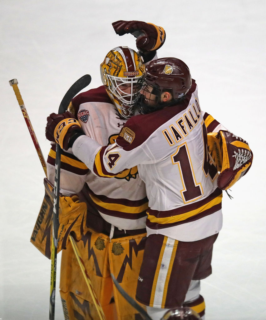 Alex Iafallo #14 of the Minnesota-Duluth Bulldogs hugs teammate Hunter Miska #35 after scoring the game-winning goal with 26 second left in regulation against the Harvard Crimson during game one of the 2017 NCAA Division I Men's Hockey Championship Semifinal at the United Center on April 6, 2017 in Chicago, Illinois. Minnesota-Duluth defeated Harvard 2-1. (Getty Images)