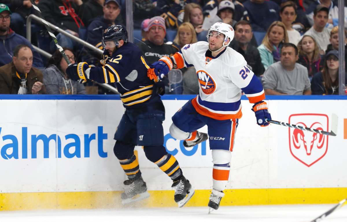 Brian Gionta and his brother Stephen of the New York Islanders collide Sunday, just as Alex and William Nylander might on Monday (Harry Scull Jr./Buffalo News).