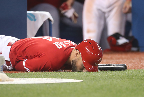Kevin Pillar's faceplant in the on-deck circle after getting hit by a foul ball during Sunday's 11-4 loss to the Orioles is a good symbol for the Blue Jays' season thus far (Getty Images).