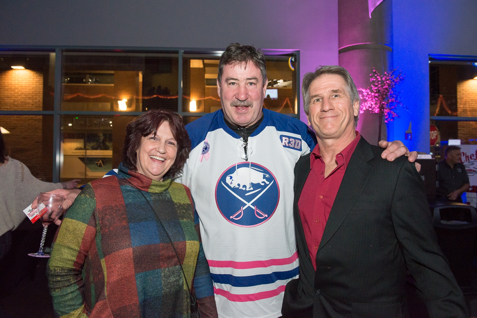 Larry Playfair, in the center at the Sabres' alumni wine festival in March, will be part of the televised NHL Draft Lottery on Saturday. (Matt Weinberg/Special To The News)