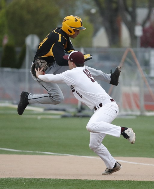 St. Joe's first baseman Nicholas Falbo tags out McQuaid's Thomas Manno during sixth inning action on Saturday. (Photo by Harry Scull Jr. / Buffalo News)