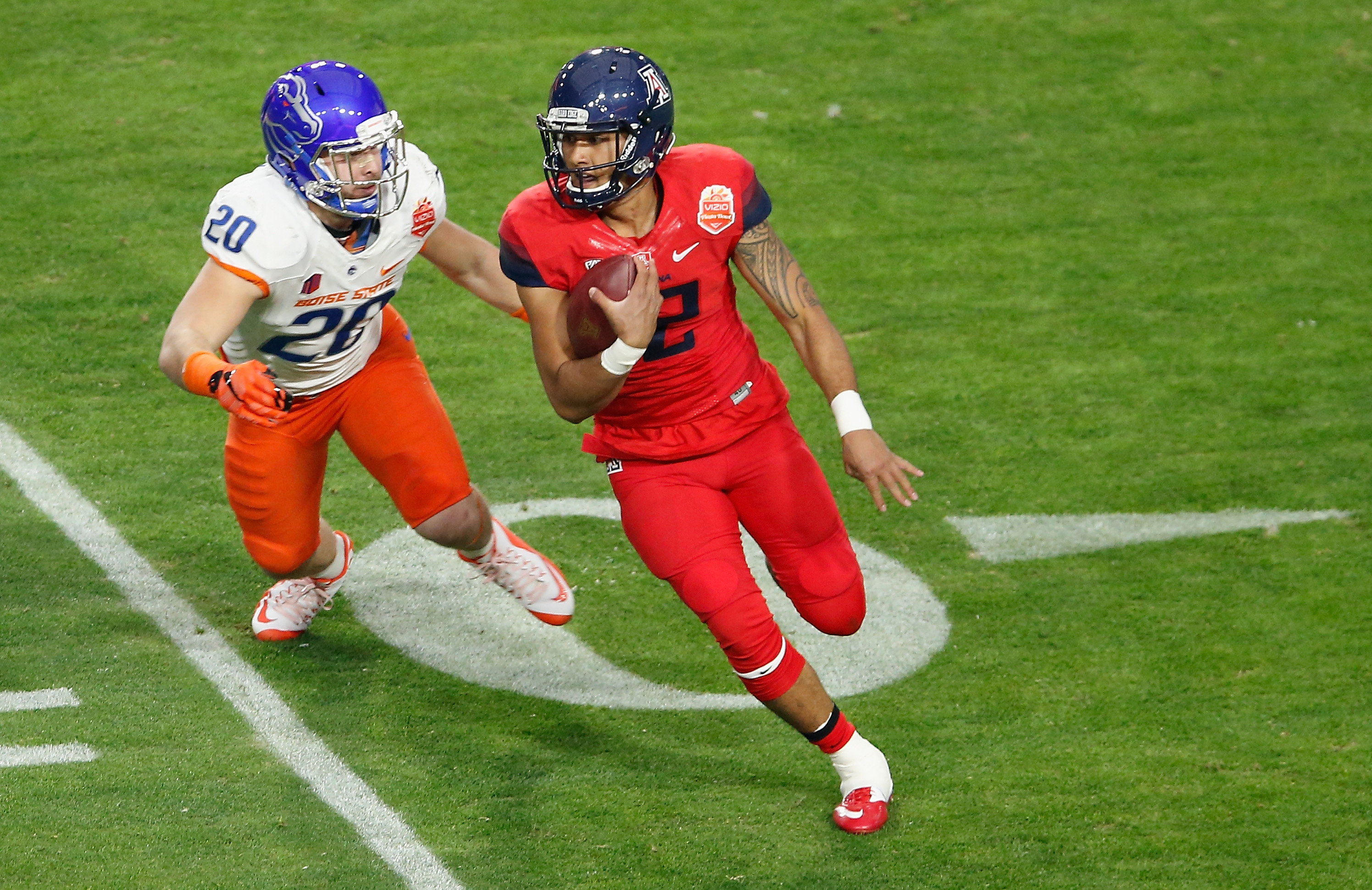 Bills sixth-round pick Tanner Vallejo pursue Arizona quarterback Anu Solomon in the 2014 Fiesta Bowl. (Photo by Christian Petersen/Getty Images)