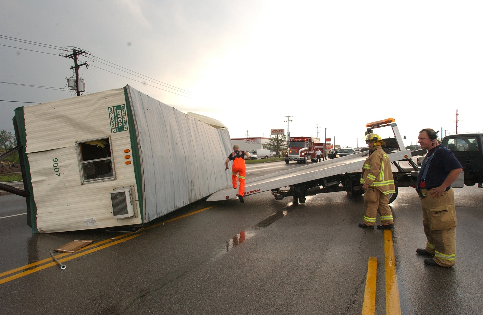 A construction trailer rests on its side after being lifted and blown several yards away to the center of Walden Avenue by a tornado that touched down in Cheektowaga in 2006. (Robert Kirkham/Buffalo News)