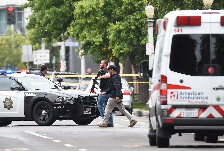 Fresno police at a shooting scene on Fulton Street north of Nevada Avenue in central Fresno, Calif. (John Walker/Fresno Bee/Tribune News  Service)