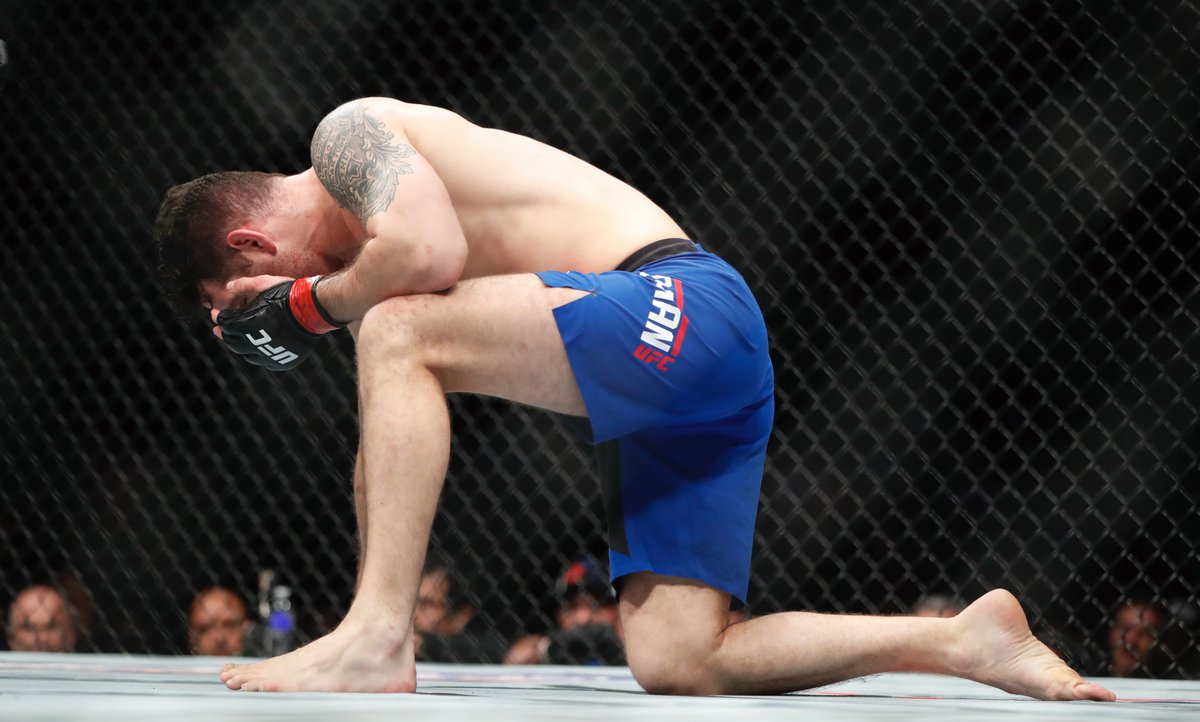 Chris Weidman takes a knee after being hit in the face by Gegard Mousasi. (Harry Scull Jr./Buffalo News)