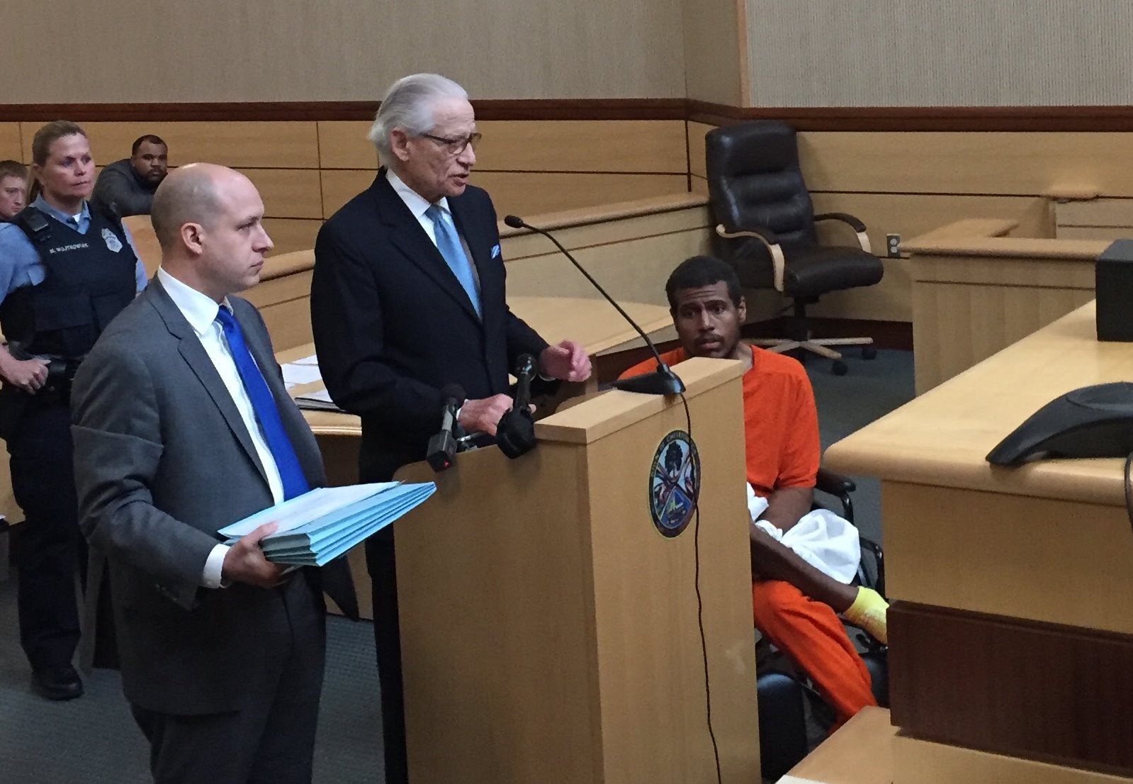 SirWilliam Hardy, right, appeared in Cheektowaga Town Court on Friday. He is accused of fatally shooting his father, William Hardy.  At center is defense attorney Joel L. Daniels and at left is Assistant District Attorney Michael Smith. (Aaron Besecker/Buffalo News)