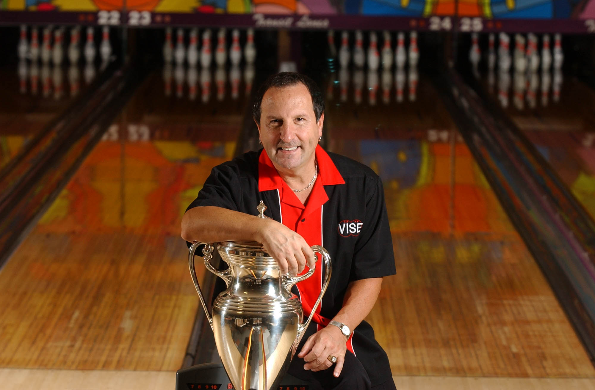 Tom Baker, pictured displaying his 2004 PBA World Championship Trophy, just won the PBA60 tournament in New Port Richey, Fla. (Buffalo News file photo)
