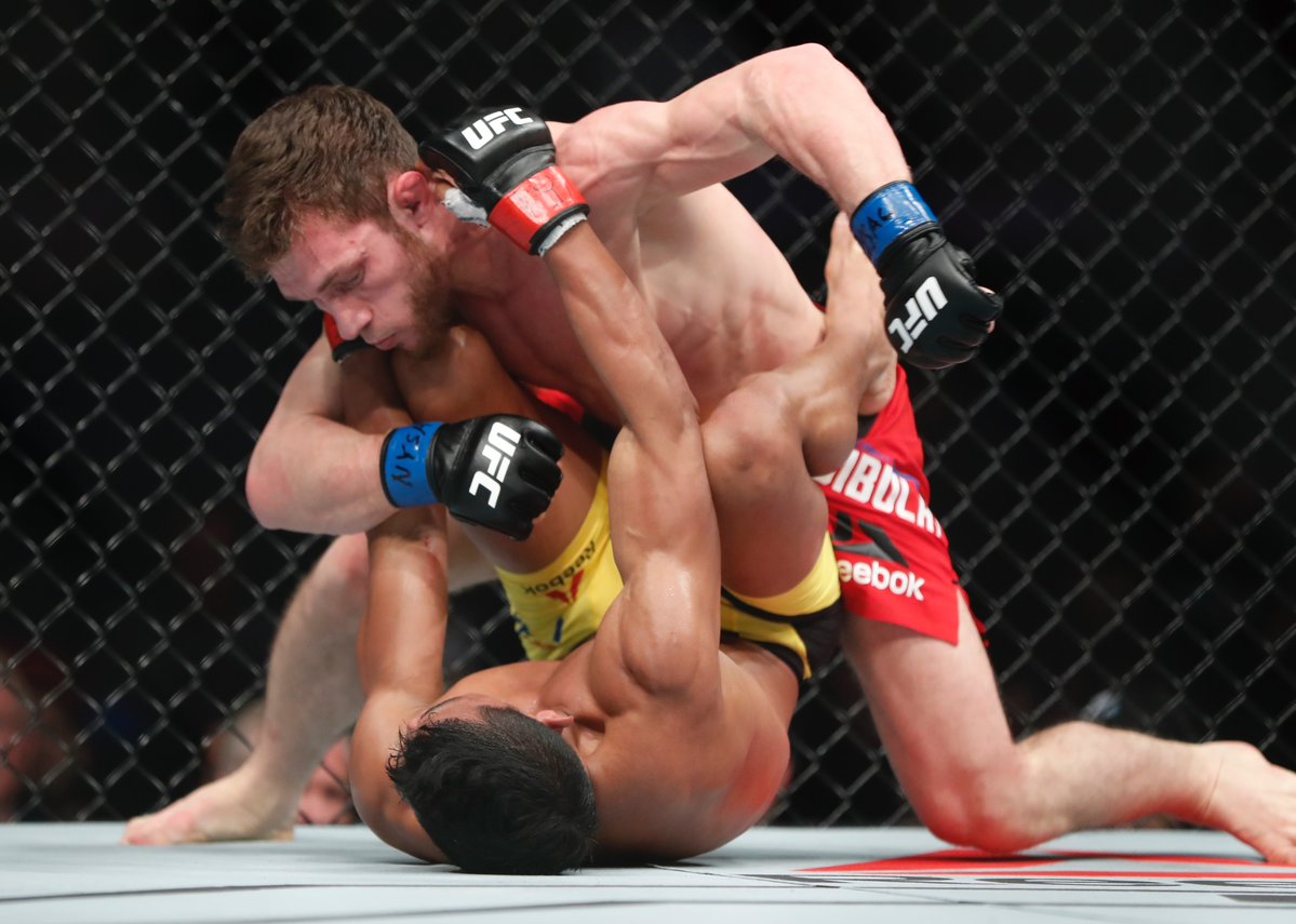 Magomed Bibulatov refuses to let up on his foe Jenel Lausa en route to the unanimous victory in his UFC debut. (Harry Scull Jr./Buffalo News)