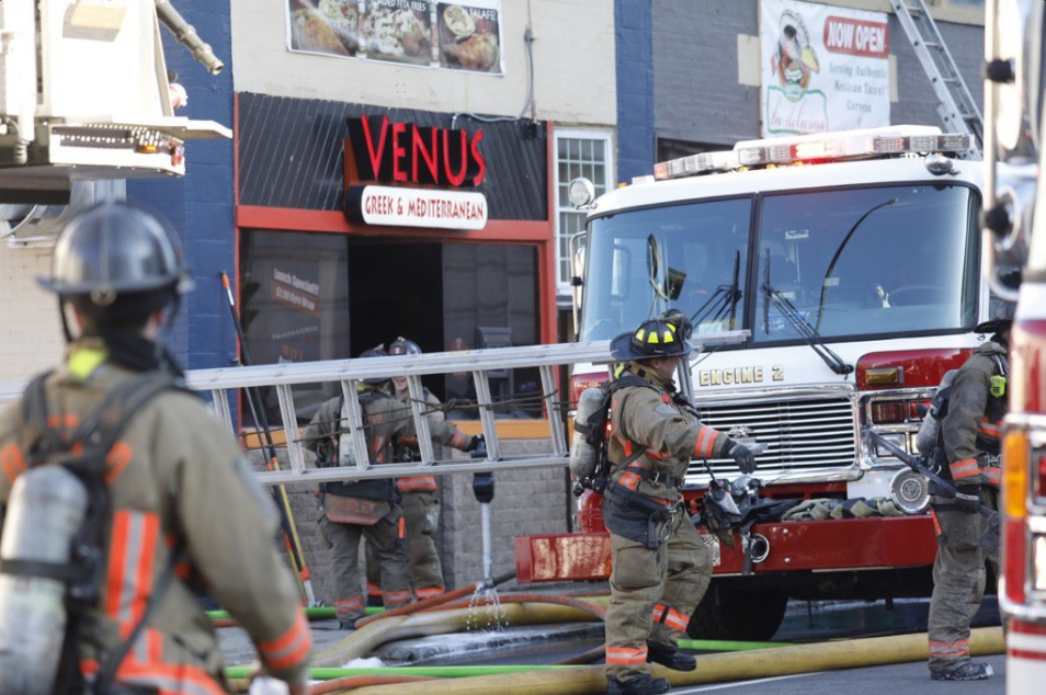 A fire Tuesday morning caused about $300,000 to La Delicias Taqueria on Pearl Street, and about $80,000 in smoke and water damage to the building next door. (Derek Gee/Buffalo News)