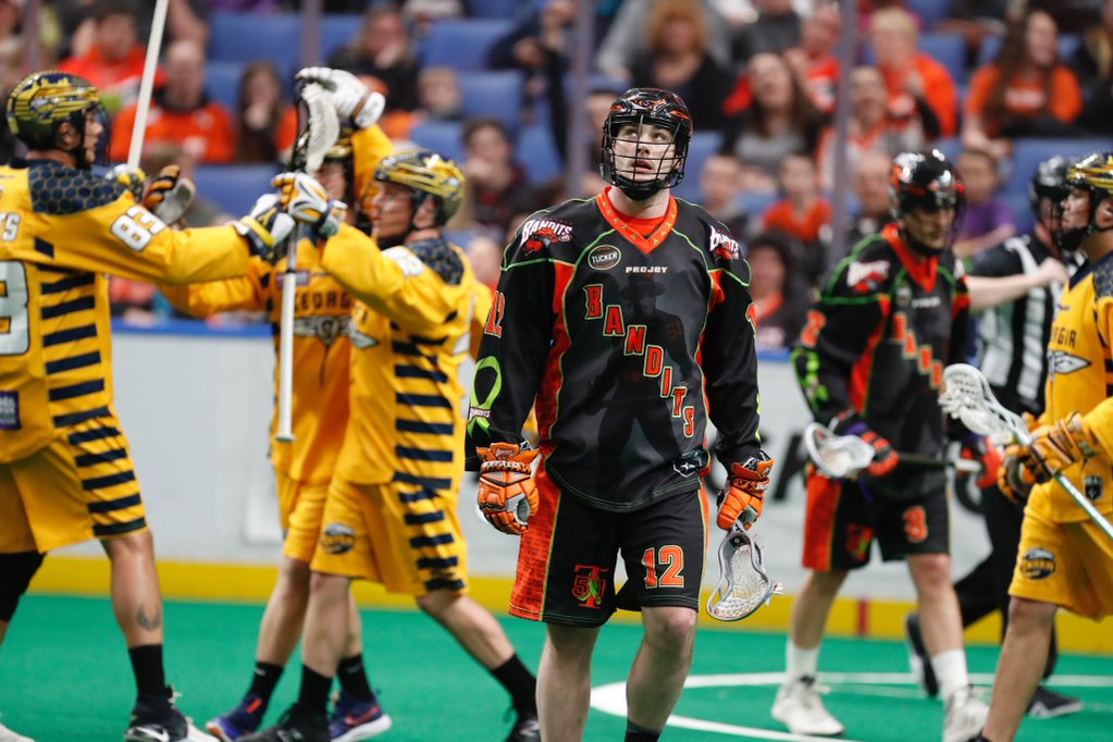 Mitch de Snoo of the Bandits wonders what's happening as the Swarm celebrate one of their 20 goals on Saturday night. (Photo by Harry Scull Jr.)