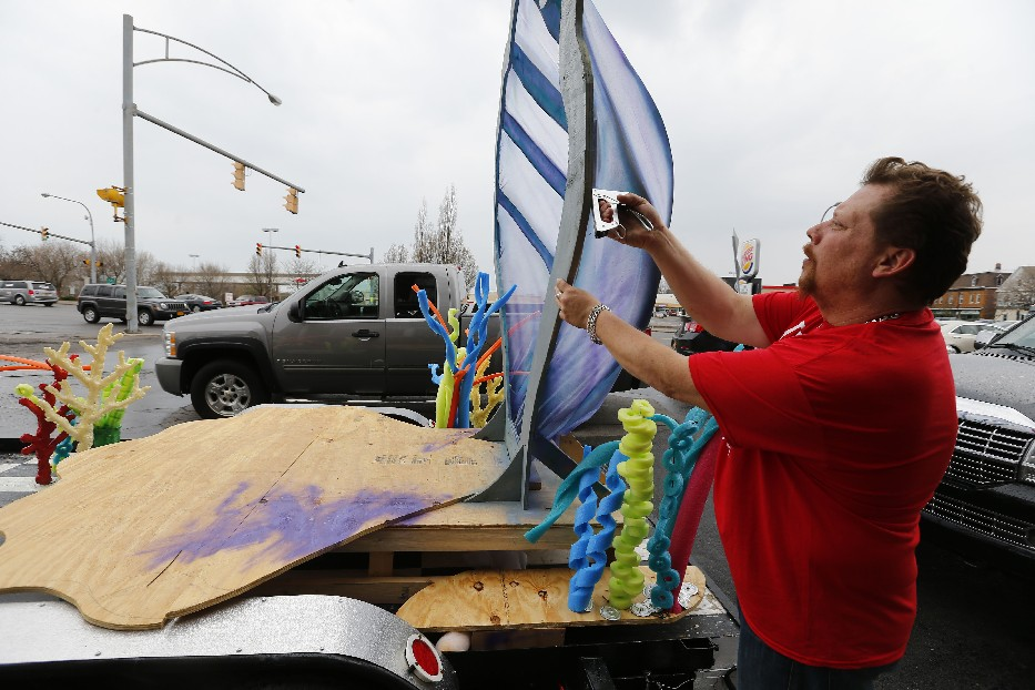 James Johnson works on the Polish Cadets' 'mermaid' themed float for the  Dyngus Day parade, where creations range from elaborate to uncomplicated. (Mark Mulville/Buffalo News)