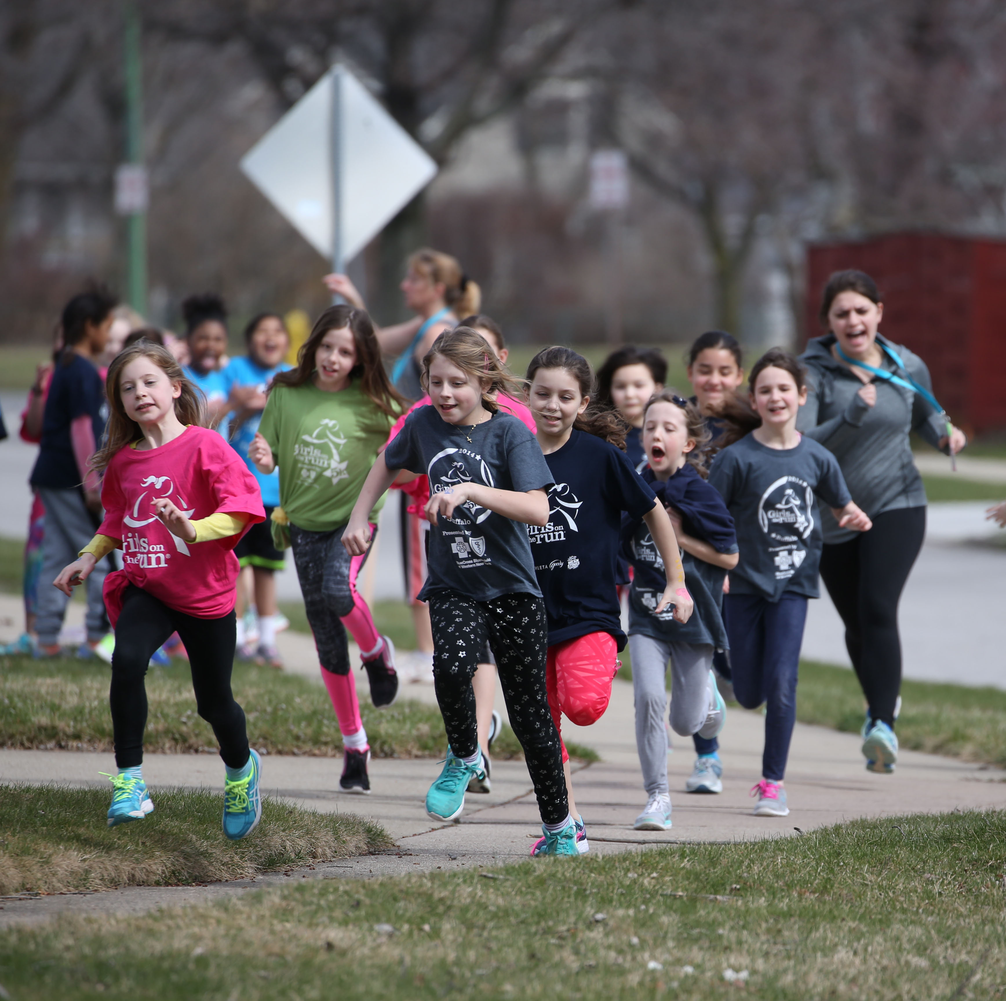 Twenty-eight girls at Forest Elementary School participate in the national Girls on the Run program. Parents and other adults can use the lessons of this and similar programs to help children develop a love for fitness, teamwork and good decision-making. (Photos by Sharon Cantillon/Buffalo News)