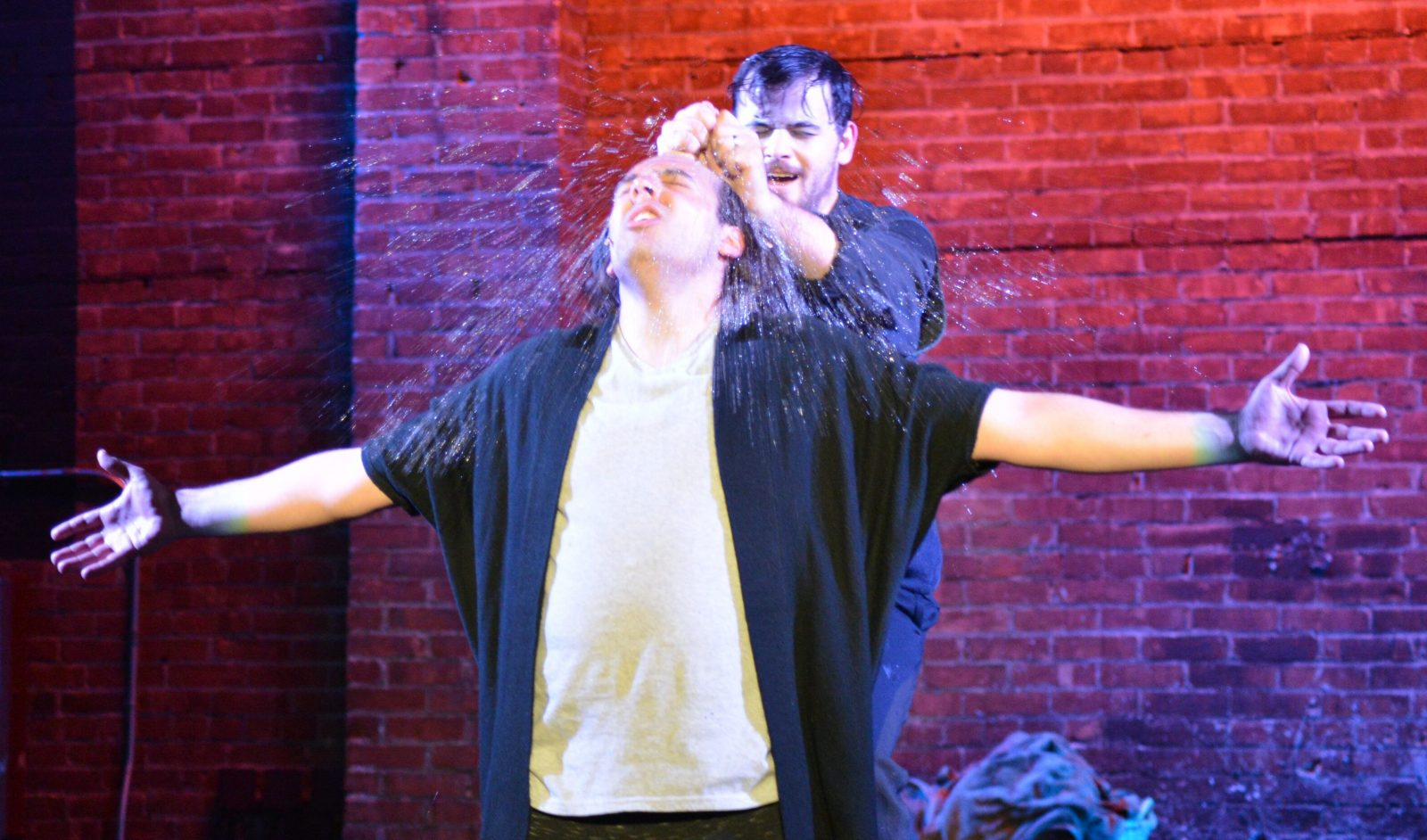 Jesus (Kyle Baran) is being baptized by John the Baptist (Tim Goehrig) in the Lancaster Opera House production of 'Godspell.'