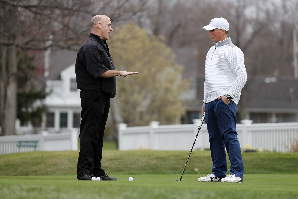 Sports performance coach Greg Liberto works with St. Francis high school golfer Mike Tomczak at Wanakah Country Club in Hamburg earlier this month. Liberto not only has improved the teen's golf game, but also his grades. (Mark Mulville/Buffalo News)