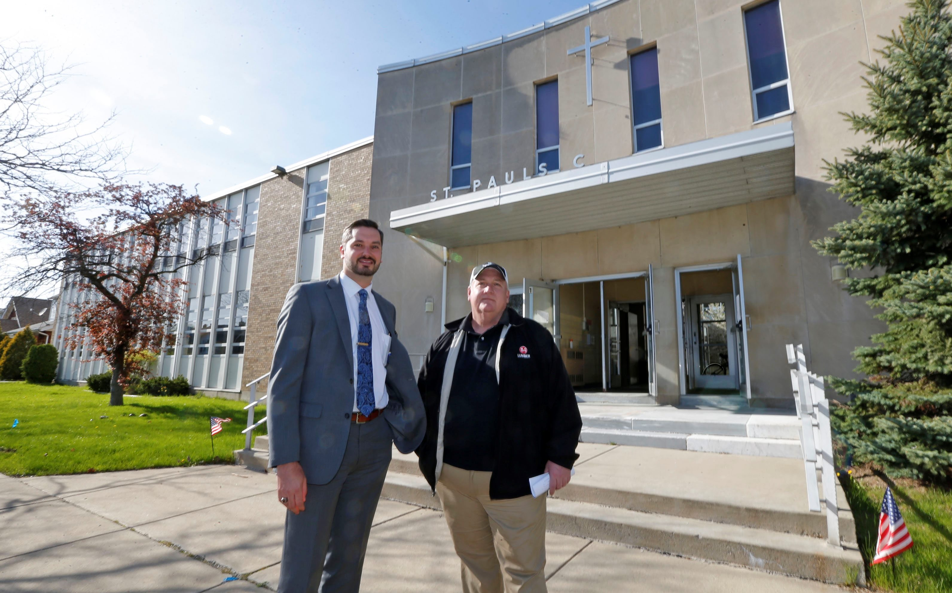 Larry Bicz, right, with his attorney Todd J. Potter, Jr.,  announced plans to begin the project that will turn the old St. Paul's school in Kenmore into 'faith-based' apartments. (Robert Kirkham/Buffalo News)
