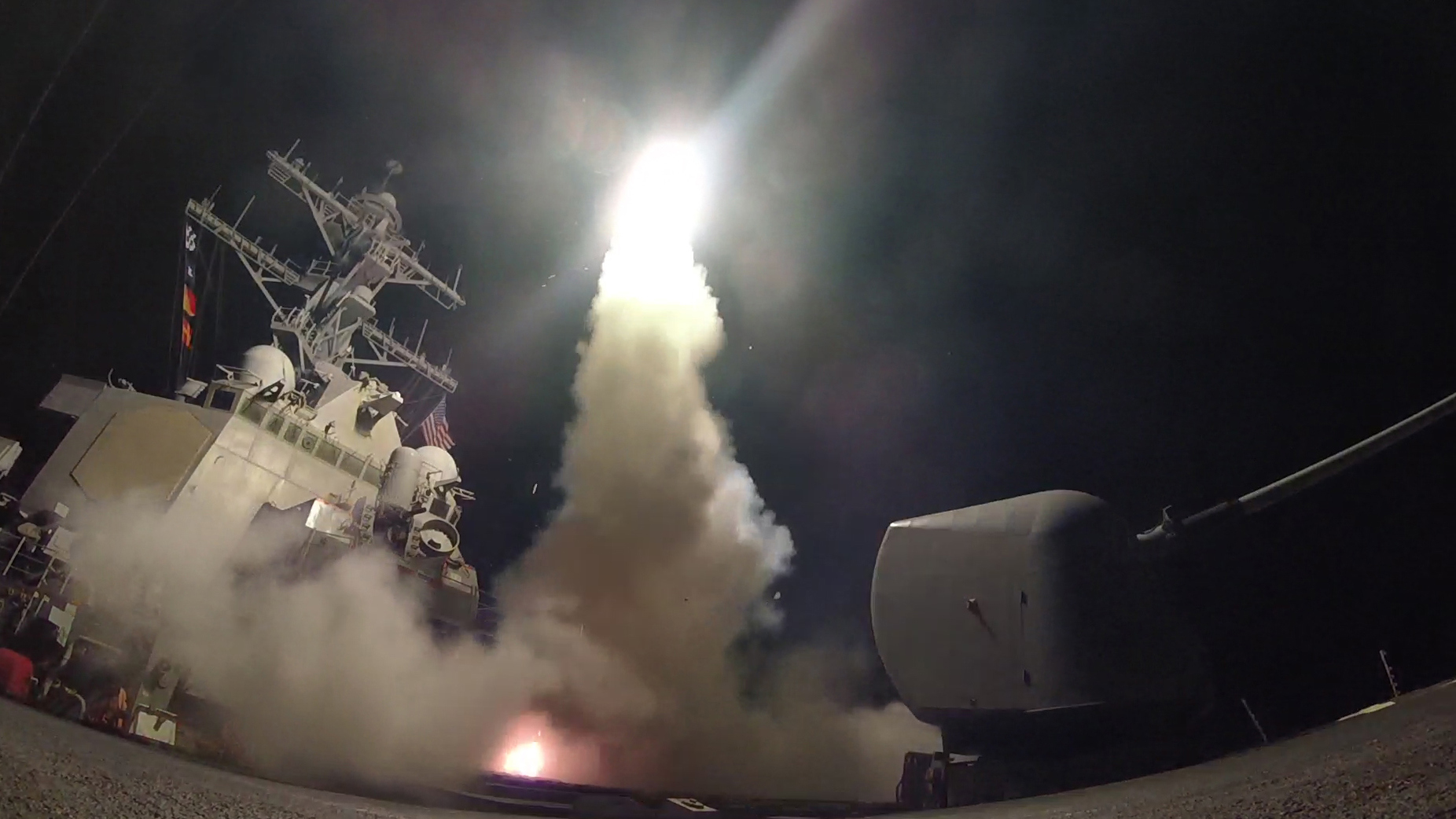 A U.S. guided missile destroyer fires a Tomahawk cruise missile at a Syrian target. (U.S. Navy photo via Getty Images)