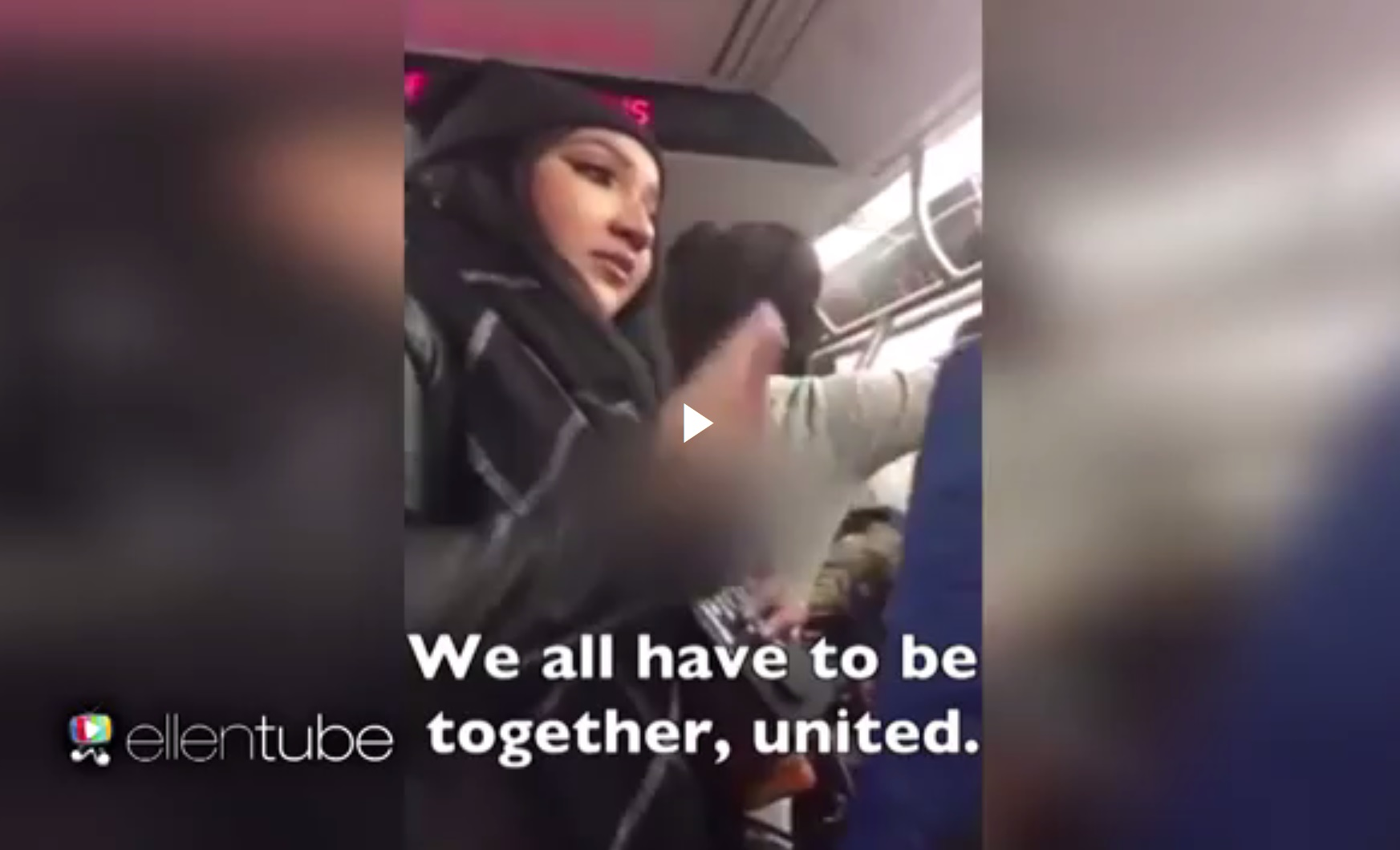 Screenshot from a video of Tracey Tong's interaction on a New York subway. (via EllenTube)