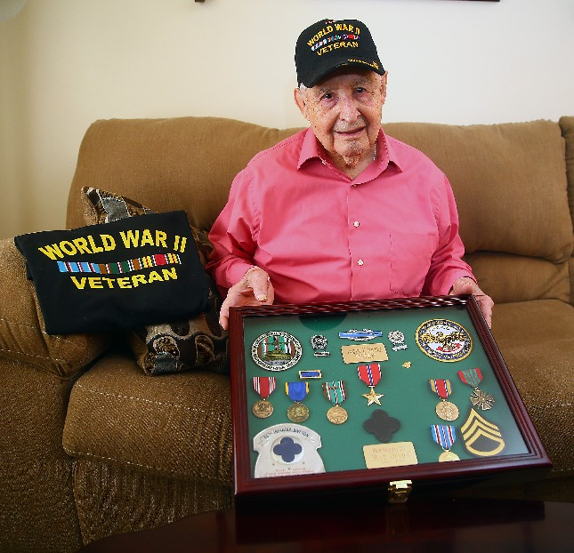 Jasper E. Rivera is proud of the medals he earned  while supplying soldiers on the front lines during WWII. (John Hickey/ Buffalo News)