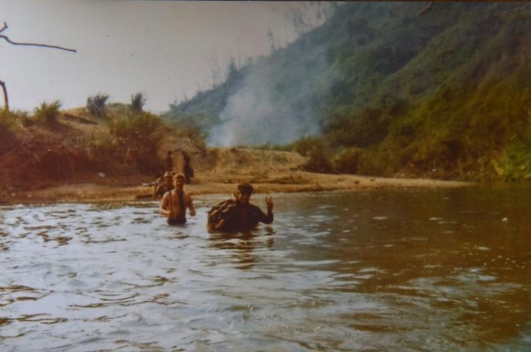 Jerry Burger, right, shown in this photo crossing the Song Bo river while an infantryman in Vietnam in 1970.