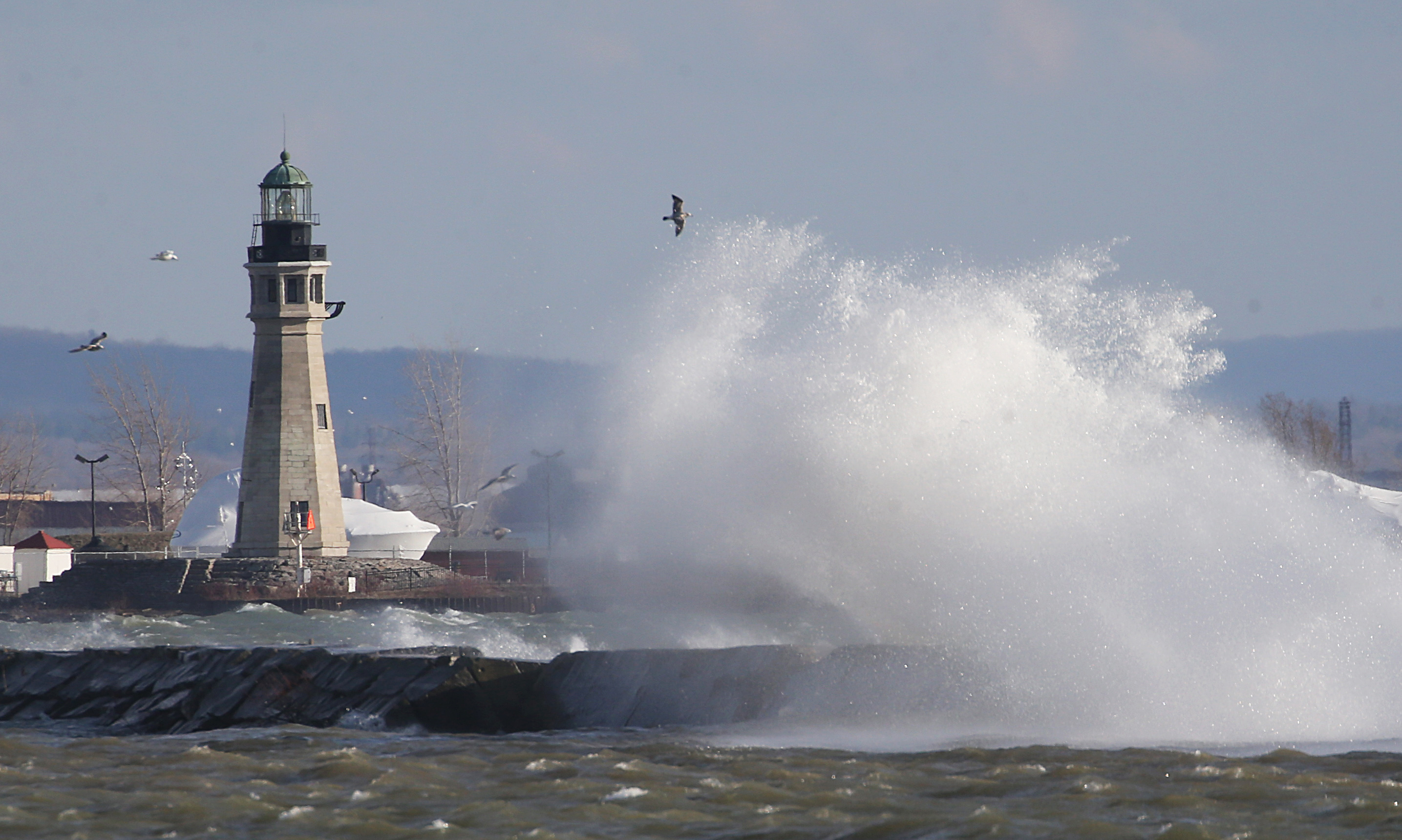 High winds produced walls of water as they crashed into the Outer Harbor breakwall on Lake Erie in Buffalo last month. The scene could be replicated later today, forecasters warn as wind gusts upward of 60 mph are expected. (Sharon Cantillon/Buffalo News)