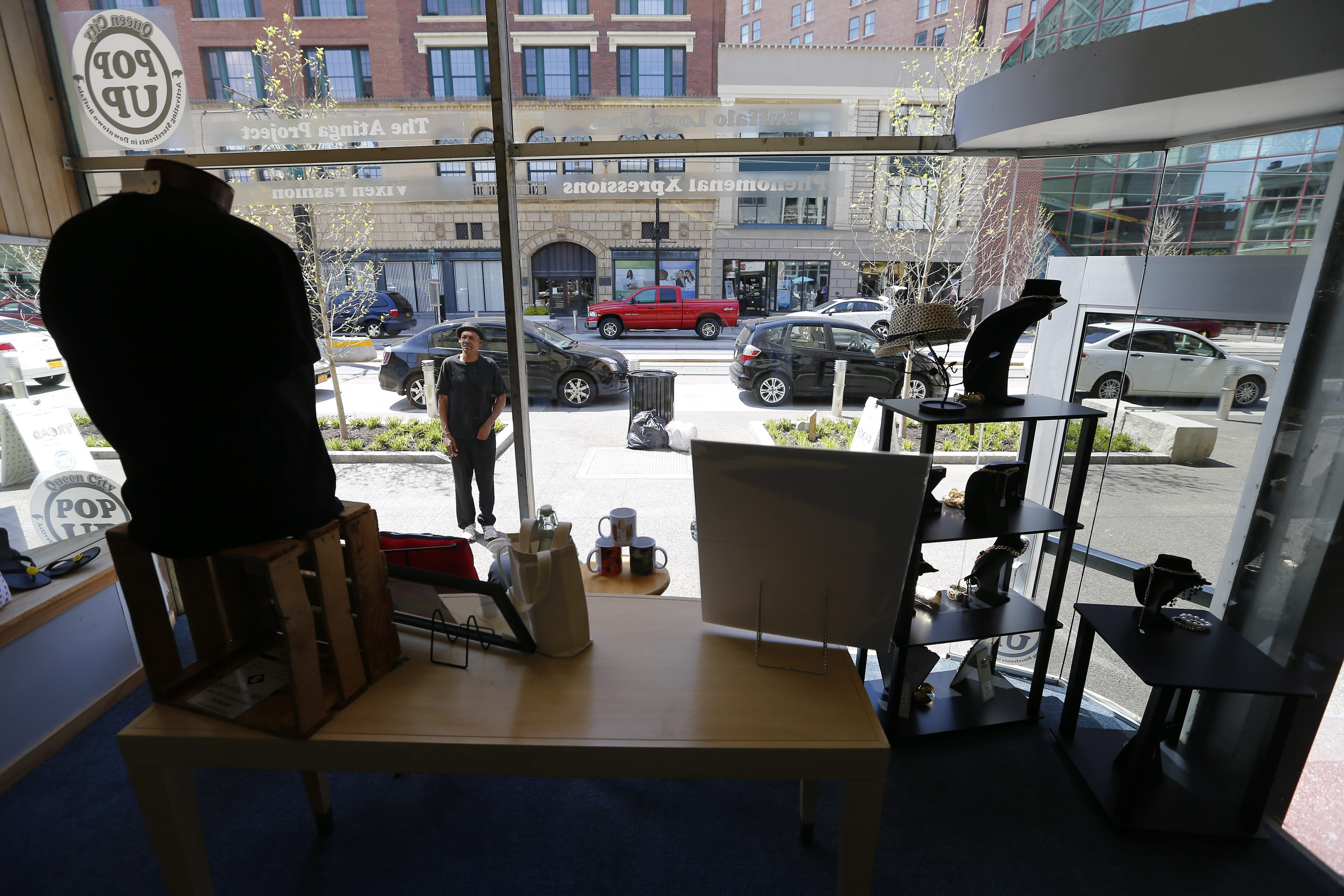 A man stops to look at the window display at Queen City Pop Up on the 500 block of Main St. in Buffalo in May 2016.   (Mark Mulville/Buffalo News file photo)