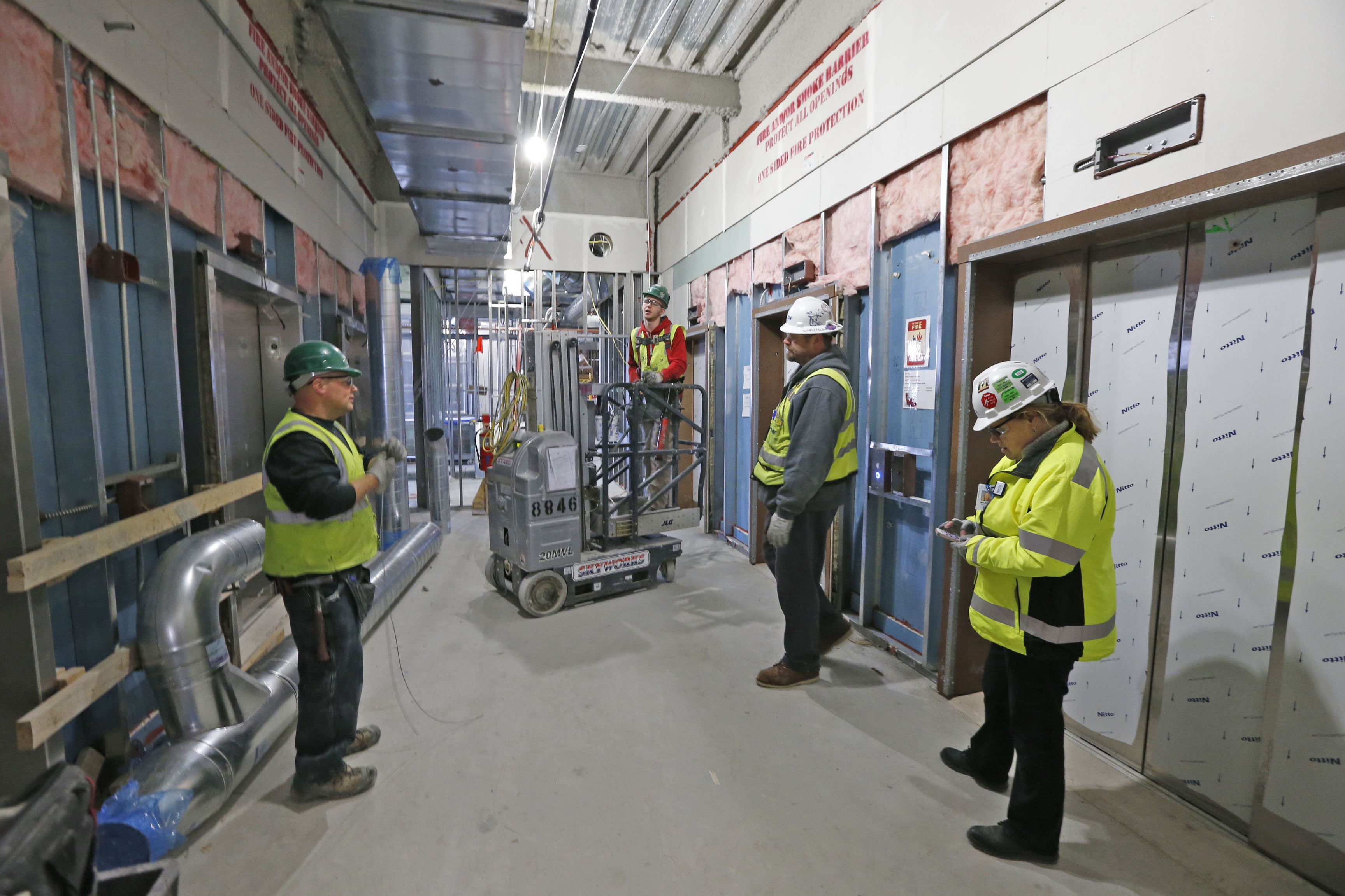 Workers wait in a hallway near the trauma elevators during the construction of the new John R. Oishei Children's Hospital in December.  (Robert Kirkham/Buffalo News file photo)
