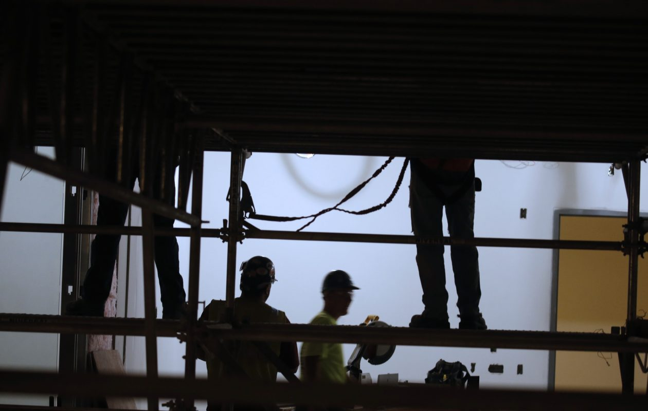 Workers climb the scaffolding in the new UB Jacobs School of Medicine and Biomedical Sciences under construction at Main and Allen streets on the Medical Campus.  This was during a tour on Monday, Dec. 12, 2016.  (Robert Kirkham/Buffalo News file photo)