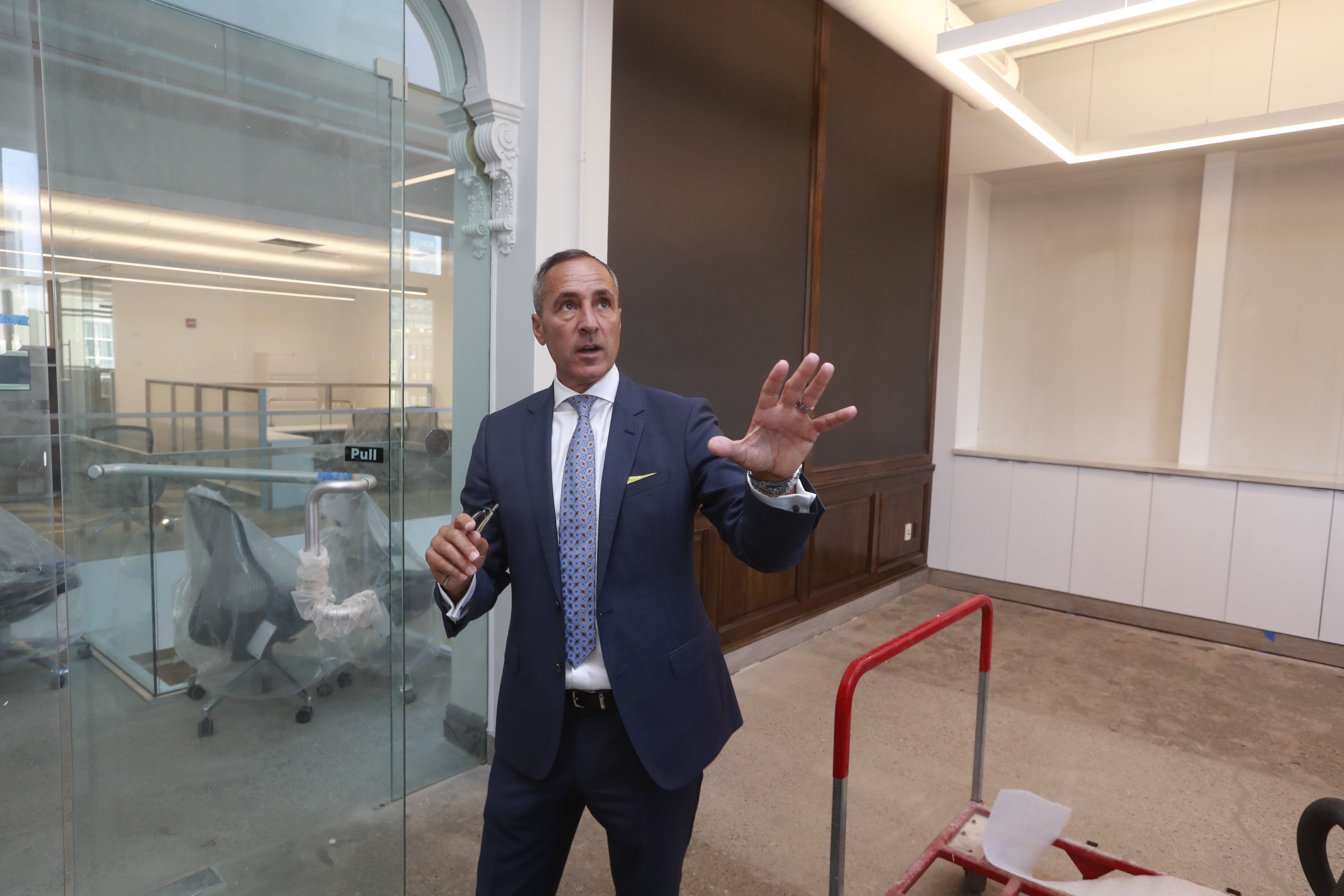 Tod Martin, president and chief creative officer of the Martin Group, talks about the renovation of the company's new headquarters on Main Street. (John Hickey/Buffalo News)