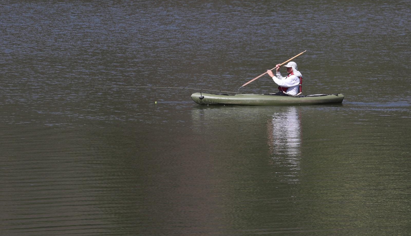 A man kayaks on Quaker Lake. (Sharon Cantillon/News file photo)