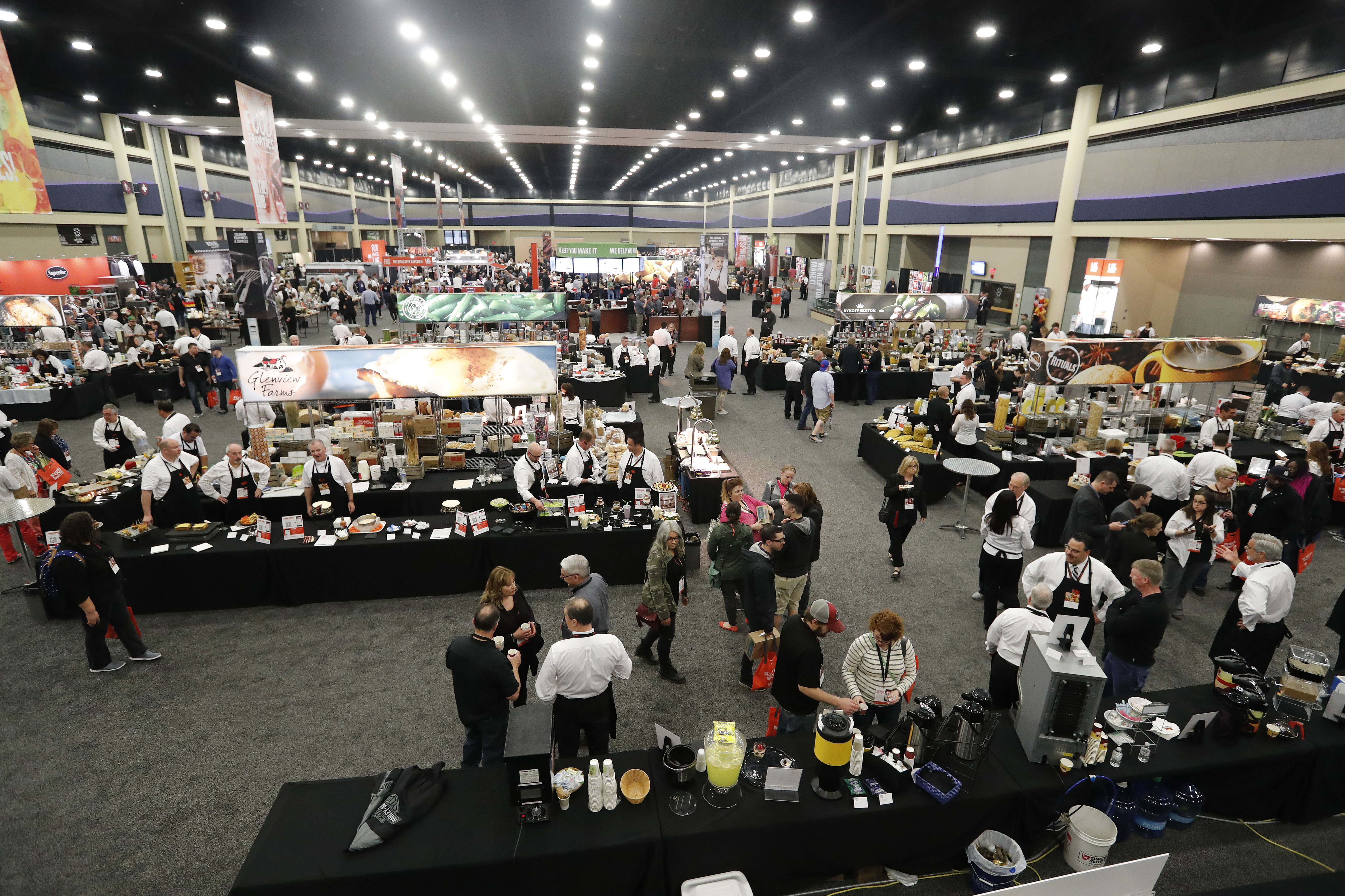 People pack the Buffalo Niagara Convention Center exhibit hall for a food show at the Buffalo Niagara Convention Center. Despite efforts to improve exhibit space, it's still considered too small and dated for many events. (Mark Mulville/Buffalo News)