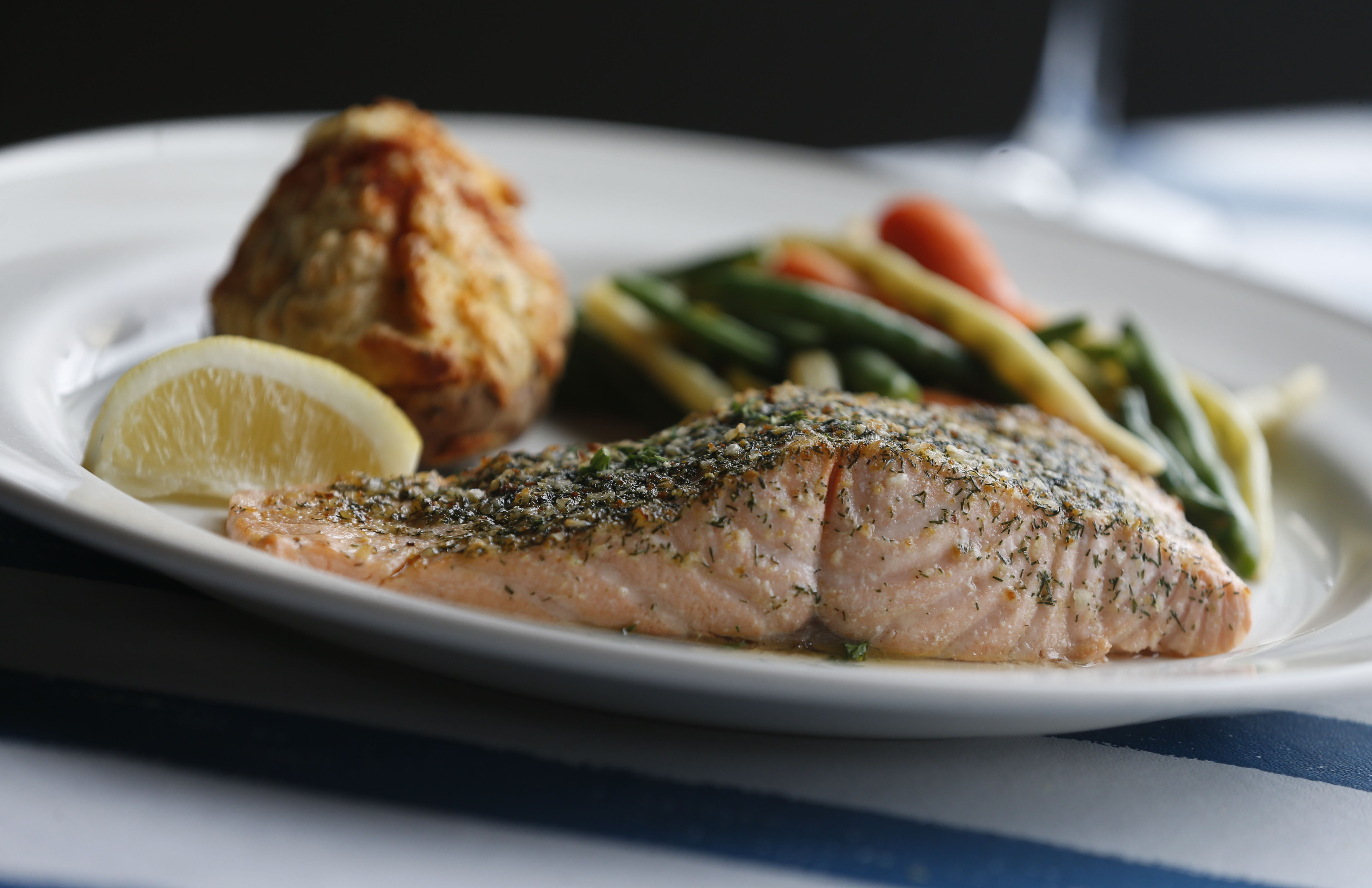At Hayes Seafood House,  the Atlantic salmon is topped with a dill seasoning and served with a twice-baked potato or other potato and a vegetable.   (Sharon Cantillon/Buffalo News)