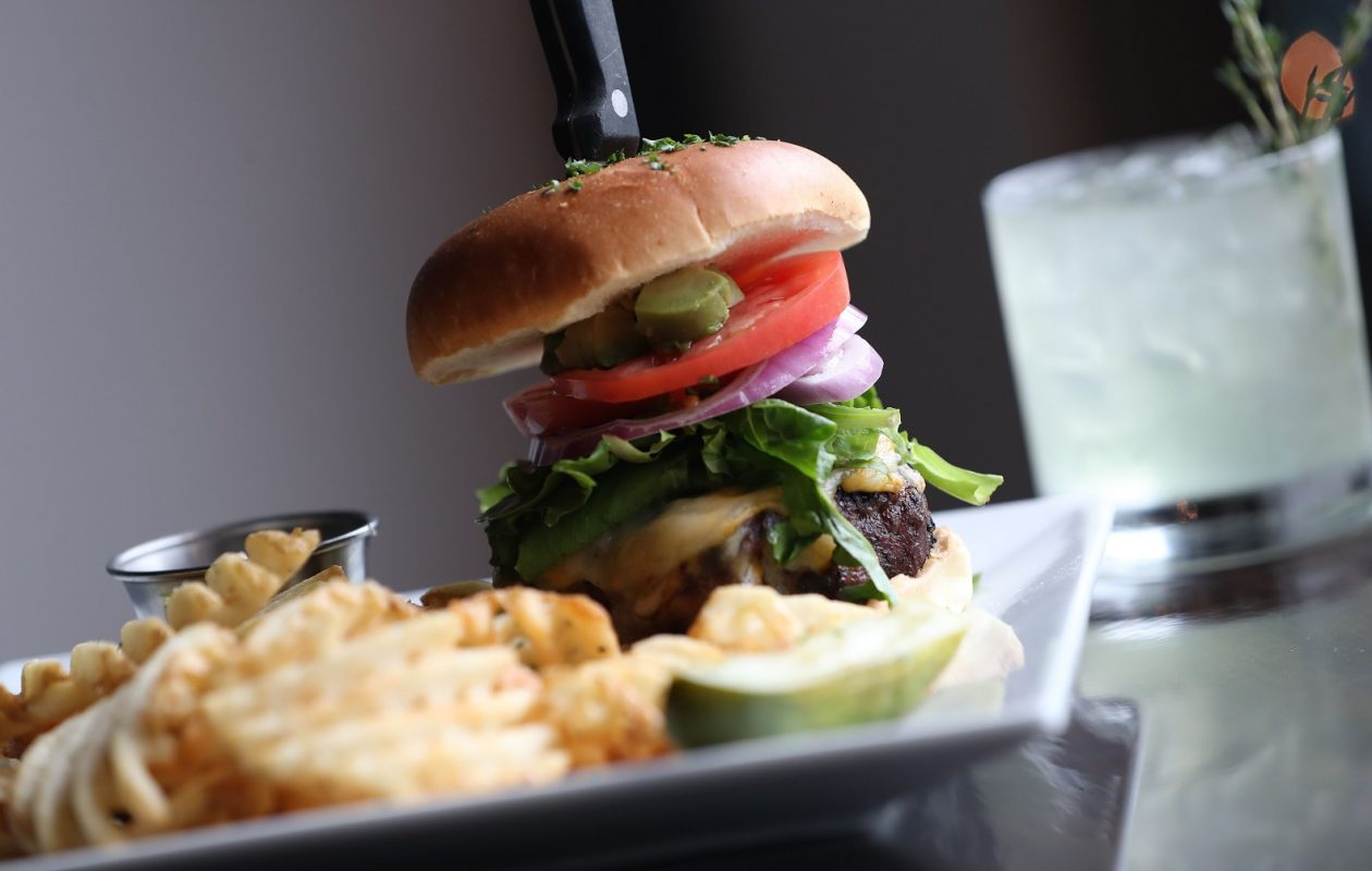 Burning Buffalo's steak burger is made from a blend of aged tenderloin, ribeye and short rib. It's topped with lettuce, tomato, onion, avocado, cheese and garlic mayo.  (Sharon Cantillon/Buffalo News)