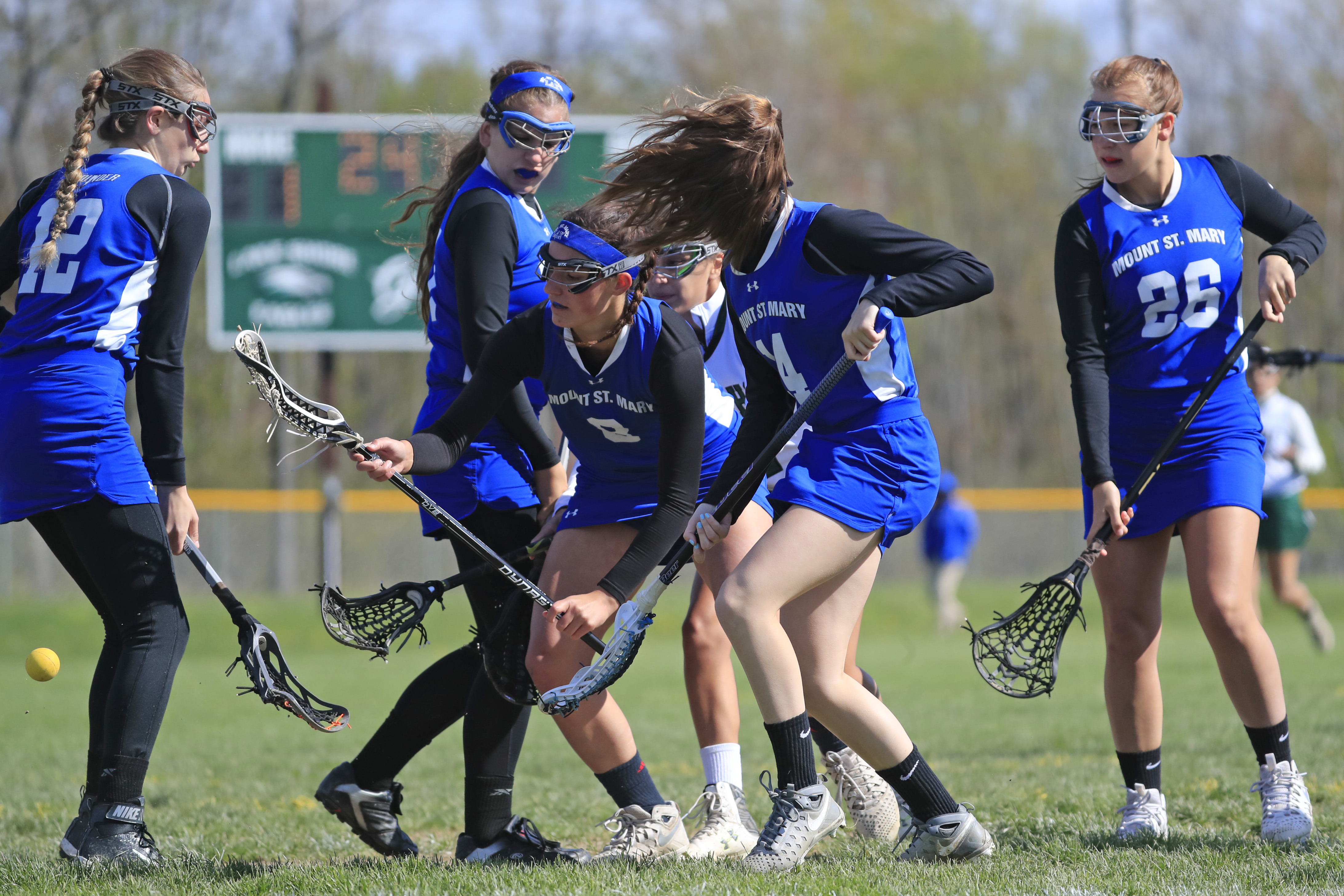 Kaitlyn Hart of Mount St. Mary looks to scoop up one of her 30 ground balls on the season for the Thunder. (Harry Scull Jr./Buffalo News)