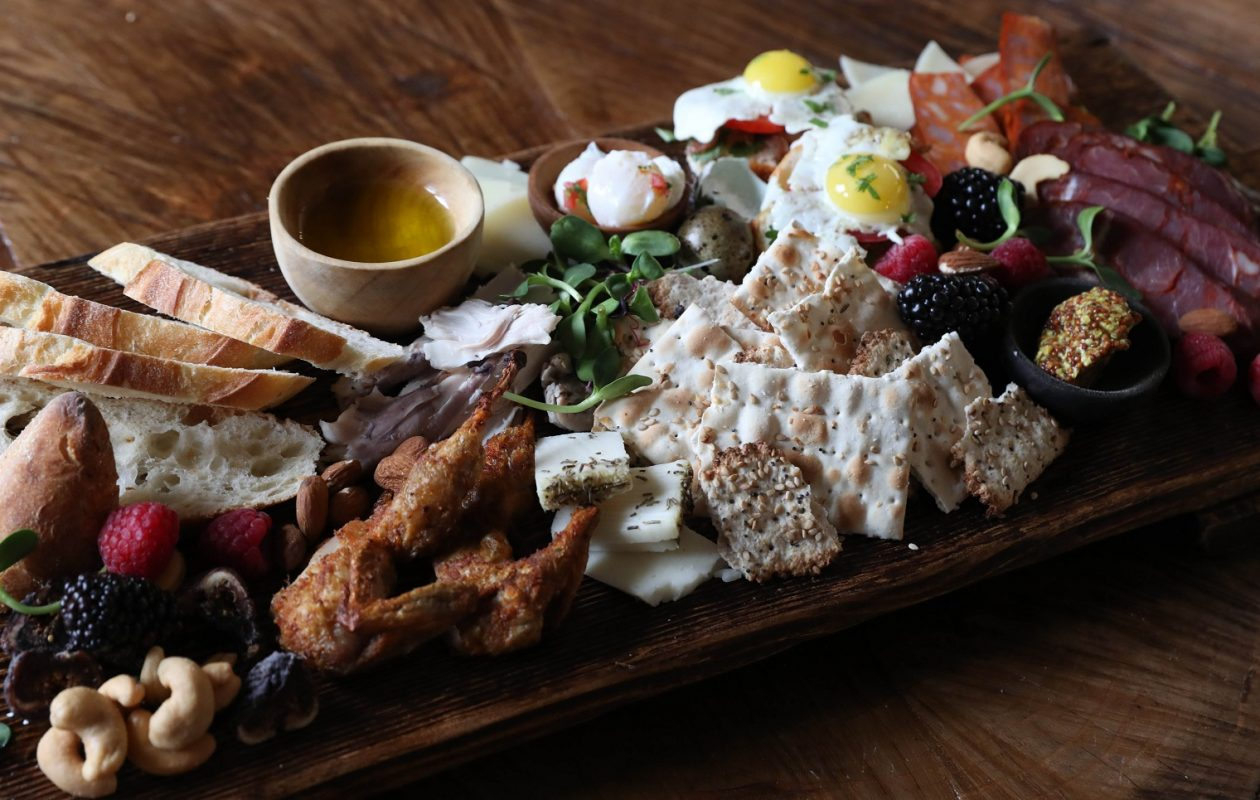 Bica e Vinho's Countryside Share Board will soon be a summer menu item.  It includes quail, quail eggs, rabbit chourico, linguica, breads, and cheeses imported from Portugal.(Sharon Cantillon/Buffalo News)