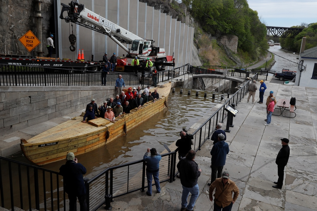 Volunteers from the Buffalo Maritime Center board The Erie Traveler, a replica of a 19th century Erie Canal cargo boat, known as a Durham Boat after it was was hoisted into the original canal locks by a crane Thursday. (John Hickey/Buffalo News)