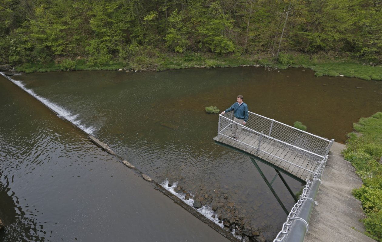 om Livak, Allegany State Park manager, looks at the dam from a look-out perch. (Robert Kirkham/Buffalo News)