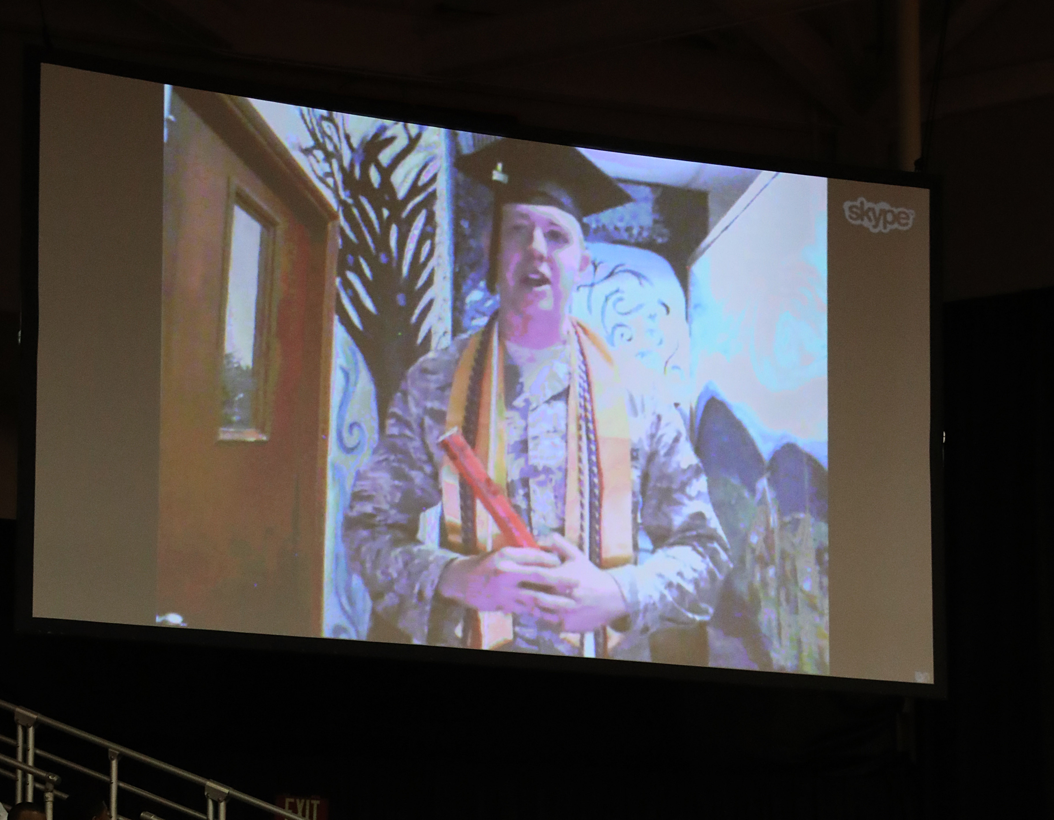 Sgt. Adam Winters, of Buffalo attends the SUNY Buffalo State graduation ceremony via Skype on Saturday, May 13, 2017. He is deployed with the Air National Guard's  109th Airlift Wing in Southwest Asia.  (Sharon Cantillon/Buffalo News)