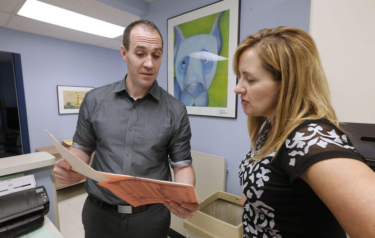 Dr. Jeremy Doak, left, speaks with Gayle Dalton, CPNP, outside the casting room at Children's Hospital.  (Robert Kirkham/Buffalo News)