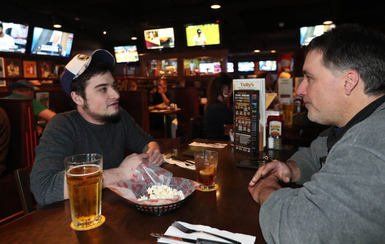 Dillan Smith and his father Paul, of Cheektowaga hang out at Tully's in Depew.    (Sharon Cantillon/Buffalo News)