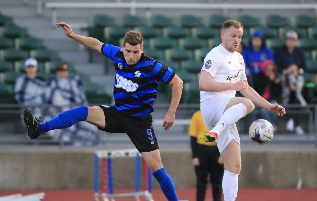 FC Buffalo's Johnathon Cary and Dayton's   Matthew Kinkopf battle for a ball during first half action at All- High Stadium on Saturday.(Harry Scull Jr./Buffalo News)